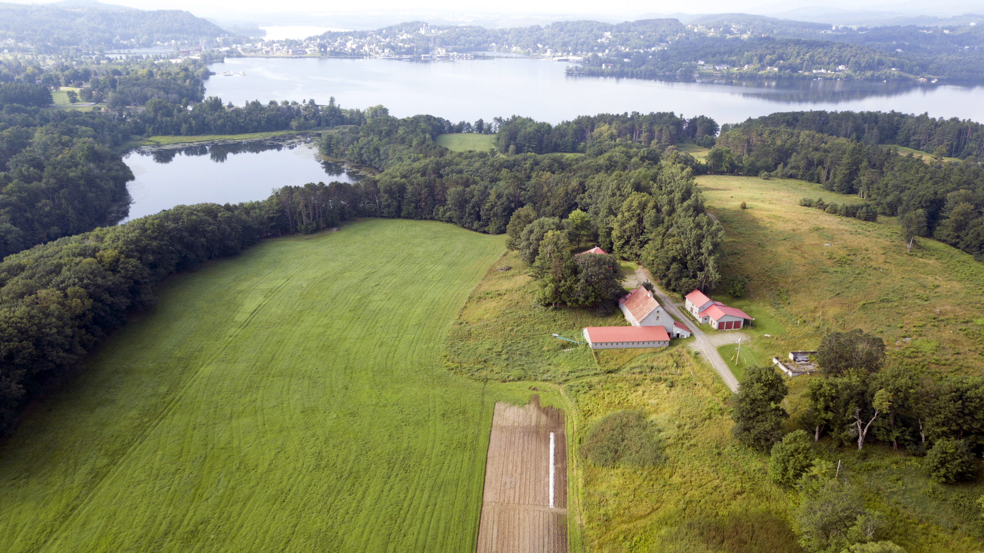 Bluffside Farm in Newport, on the shores of lake memphremagog. Photo by Caleb Kenna, Courtesy of Vermont Land Trust.