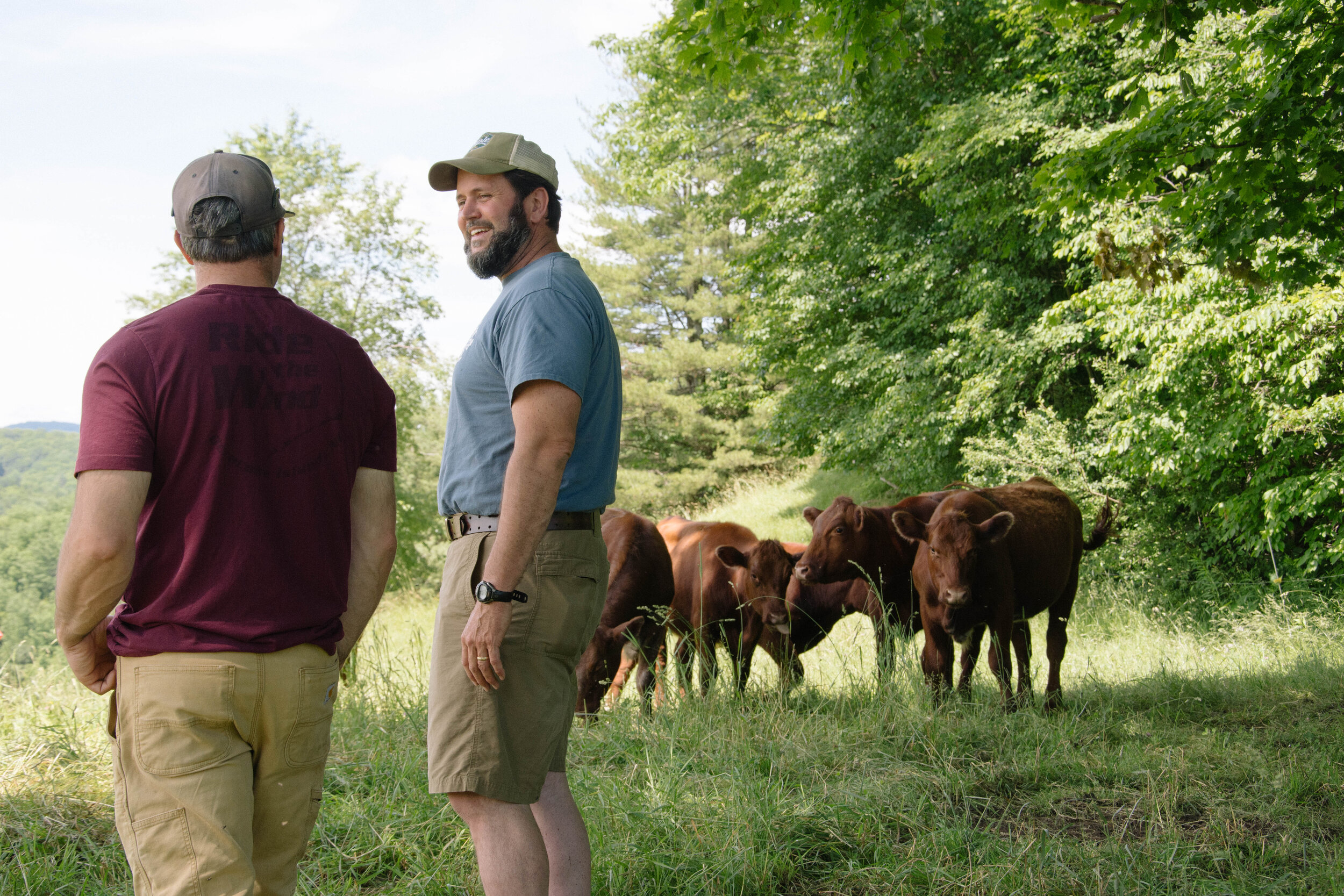 KEVIN CHANNELL, FARM BUSINESS SPECIALIST FROM THE INTERVALE CENTER, SPEAKS WITH BEN HALLEY OF SECOND WIND FARM. IMAGE COURTESY OF THE INTERVALE CENTER.