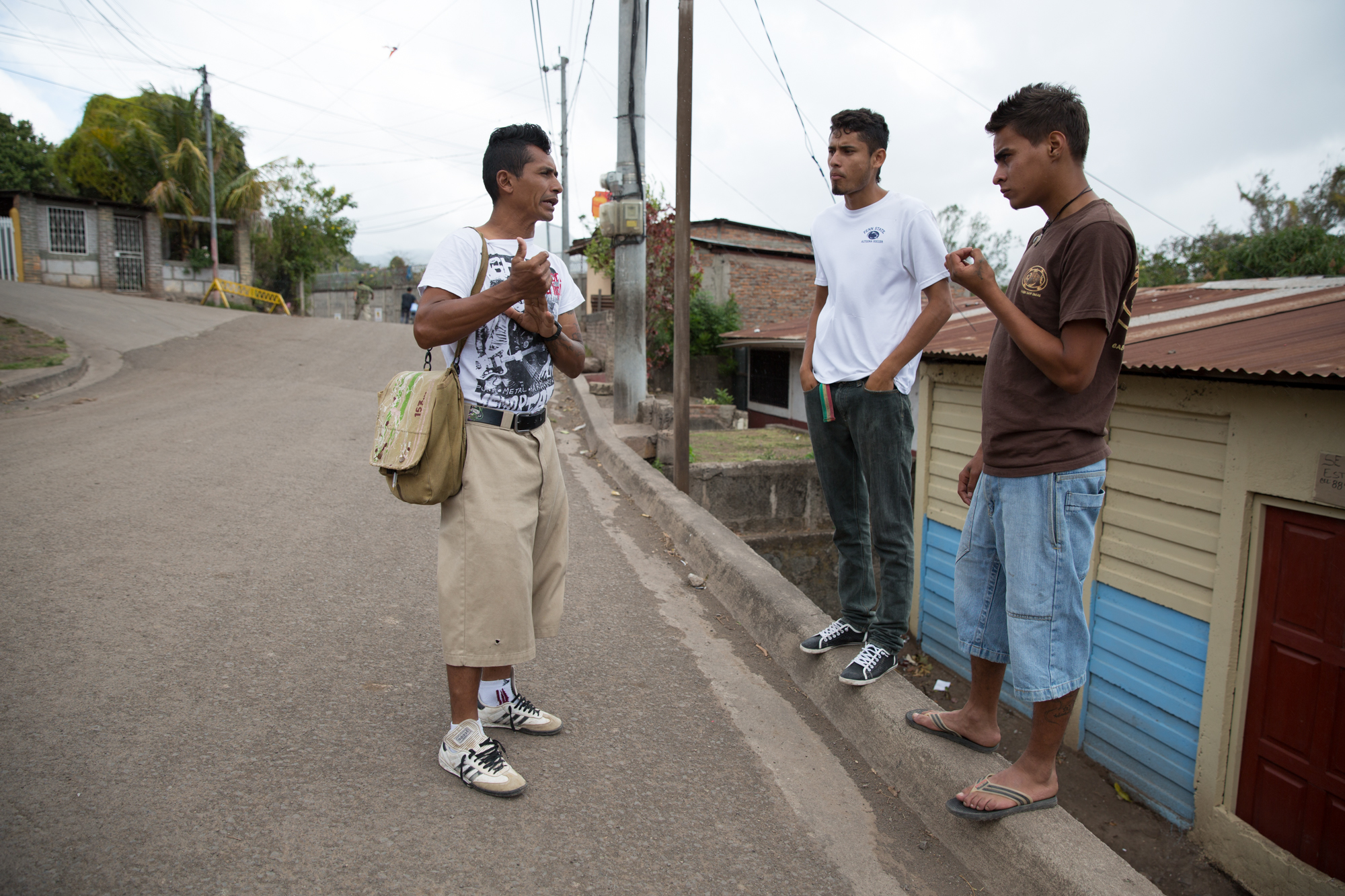 Jairo Blanchard (left) speaks with two boys in his neighborhood who are members of a gang called Mata Perros (The Dog Killers). He says this gang is one of the ones he has a lot of problems with because some of the members are involved with alcohol and drugs.