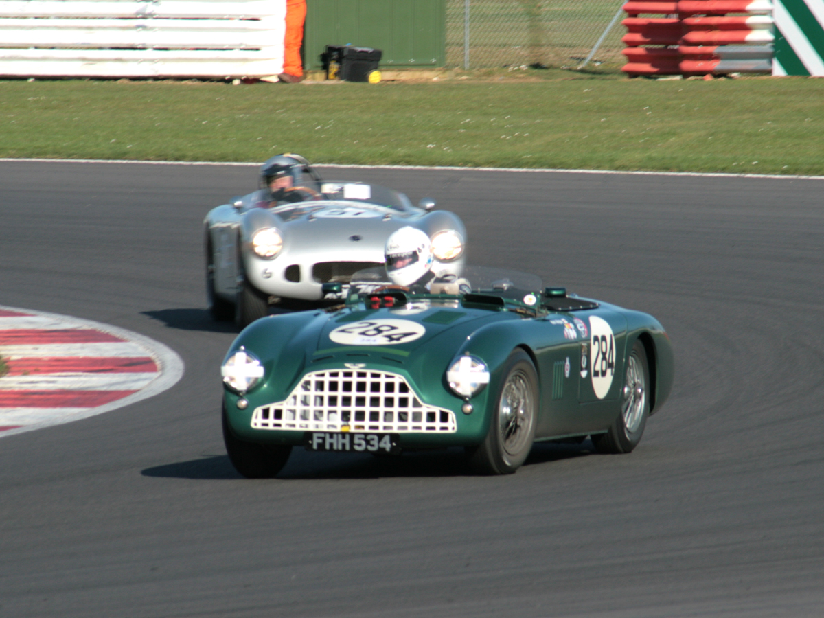 Chris Woodgate takes Mark Midgeley's DB3 ahead of Spike Milligan's HWM Jaguar on the way to a narrow victory.