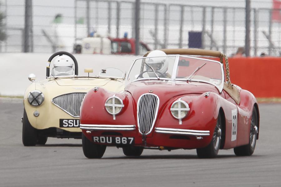 Geoff Ottley in his Jaguar XK120 has Austen Wells undivided attention! Photo - Mick Walker