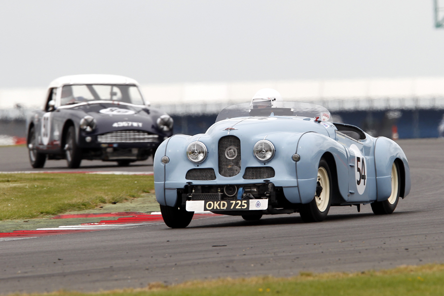 Newcomers both. Richard Gane in his charismatic Jowett Jupiter about to be lapped by Peter Adams in his Turner Climax.     Photo - Mick Walker