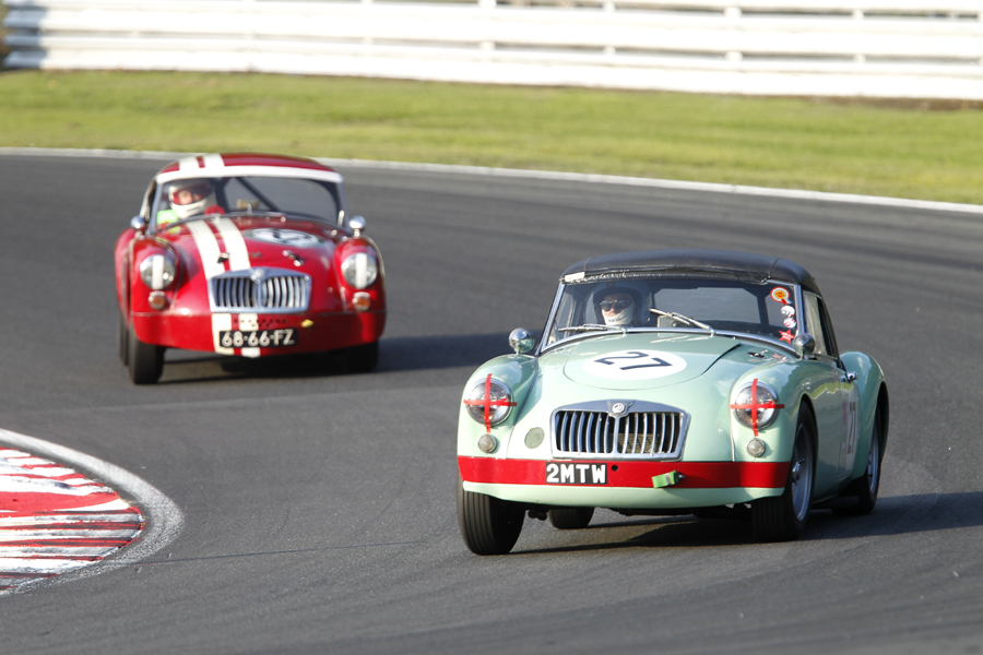 Abingdons finest! Roger Daniell's ex works twin cam MGA leads Shaun Bromley.  Photo - Mick Walker