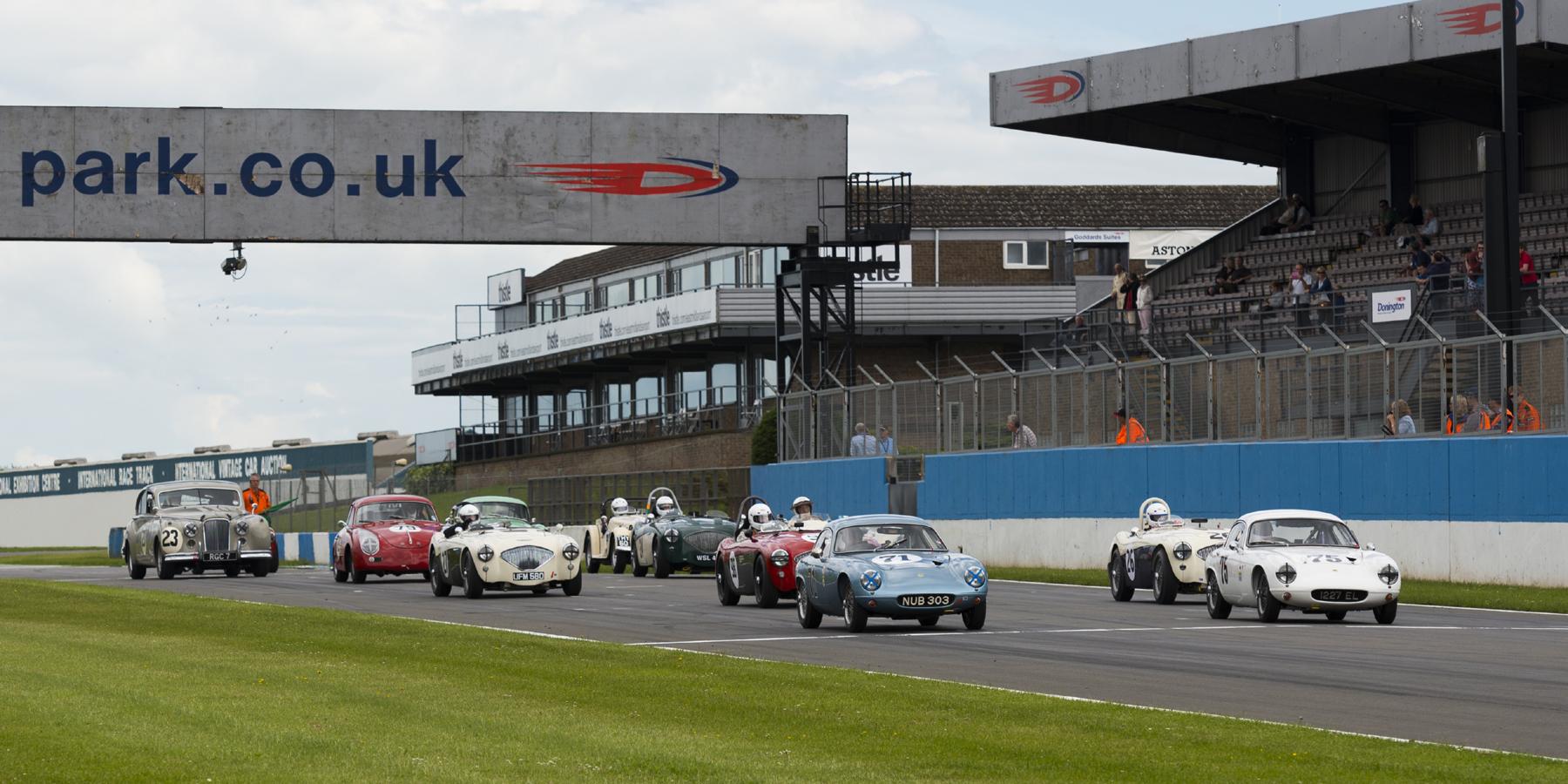 Startline. The grid dwarfed by Graham Love's Jaguar Mk VII.      Photo - Rich Corbin