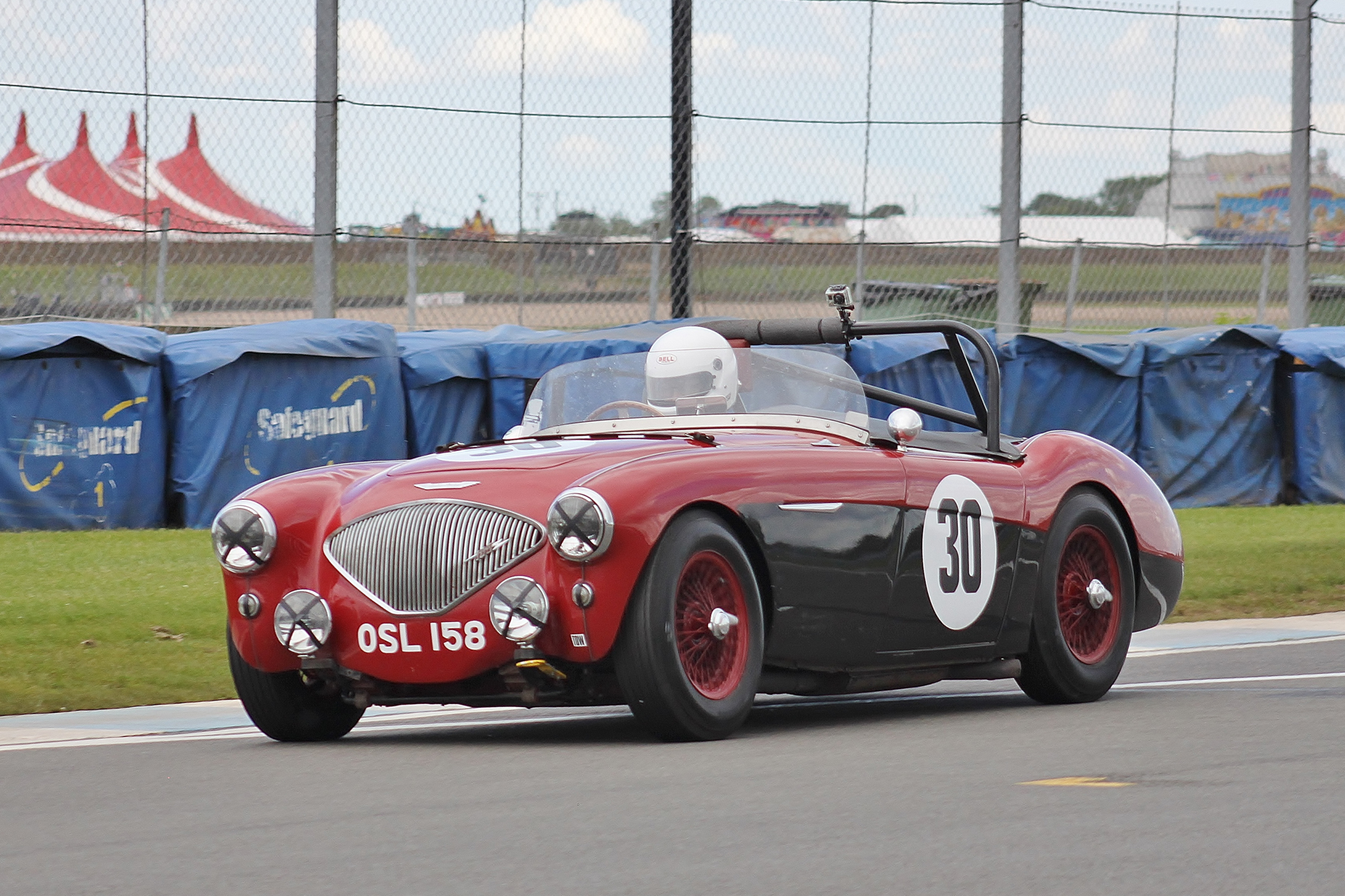 James Pugh-Lewis and Keith Jenkins in their first race with FISCAR. This is James.The two tone colour scheme particularly suits the Austin Healeys and it is further enhanced here with the colour matching wheels.               Photo - Bob Bull