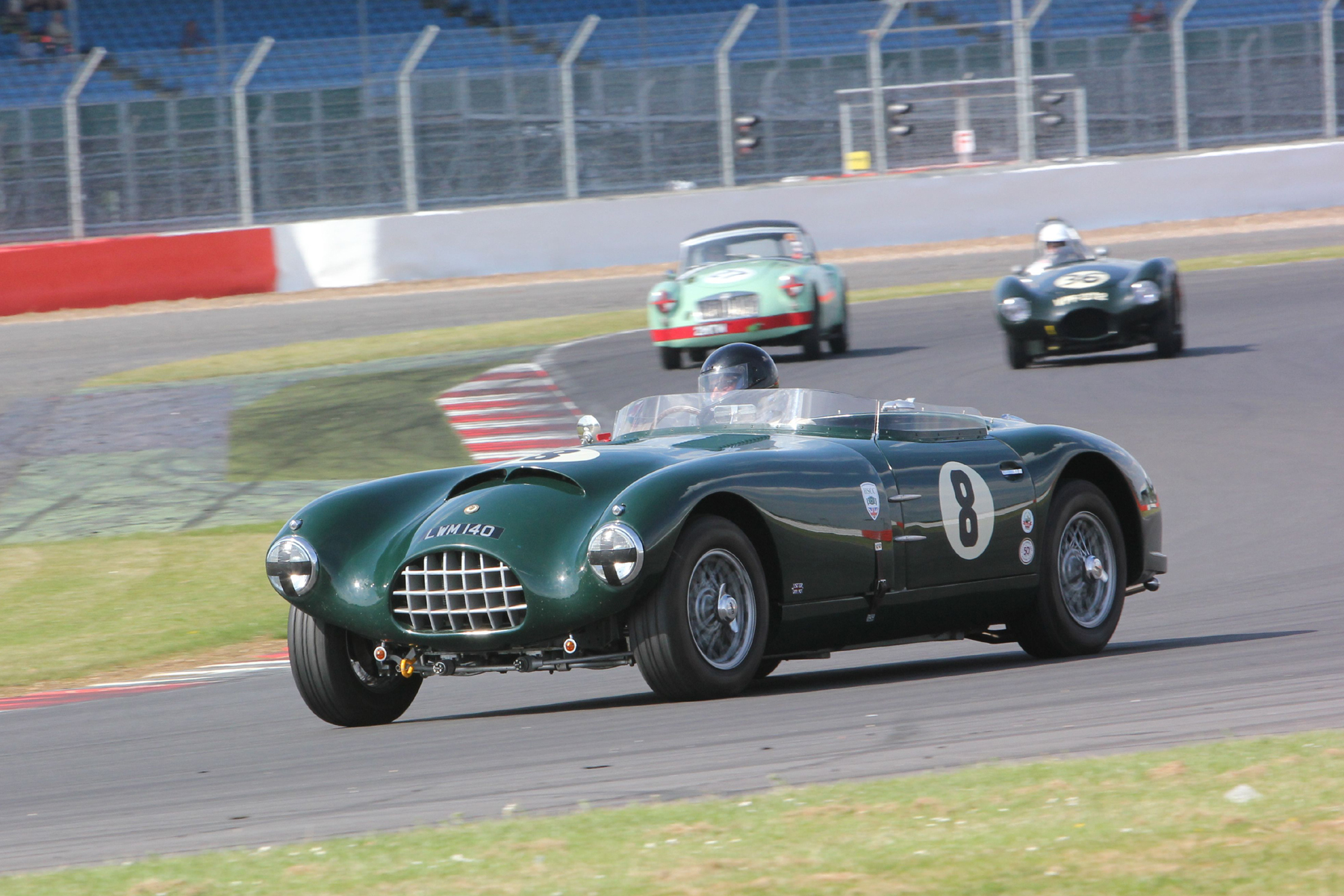 Charles Fripp (Gomm Jaguar) runs ahead of Paul Griffin (Connaught ALSR) and Roger Daniell (MGA Twin Cam)  Photo - Pat Arculus