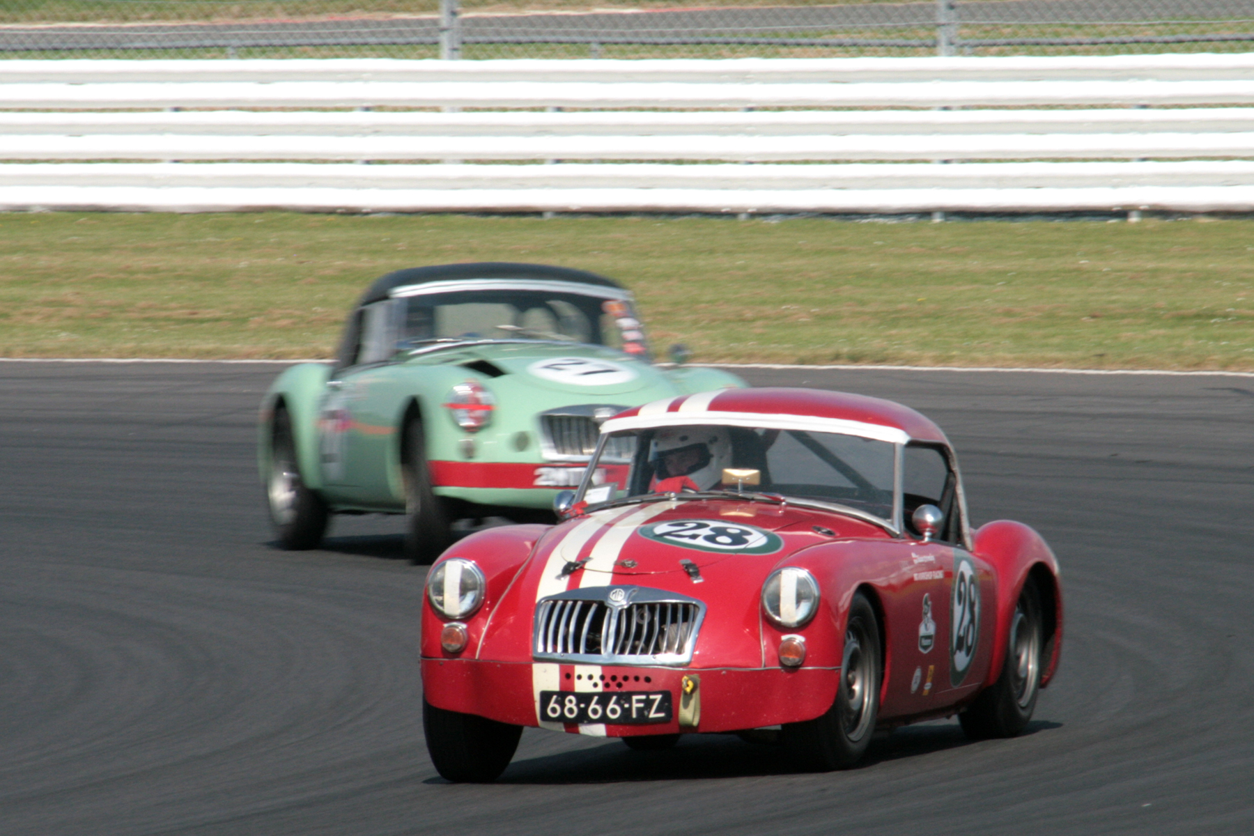 Shaun Bromley holds off Roger Daniell in their splendid MGA duel to the finishing line.               Photo - John Turner