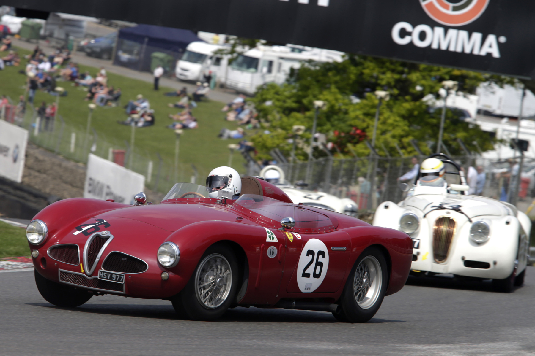 Christopher Mann's gorgeous Alfa Romeo Disco Volante rounds Druids chased by Christopher Scholey (XK120) and Nigel Grice (Austin Healey 100M)                                                       Photo - Gary Hawkins
