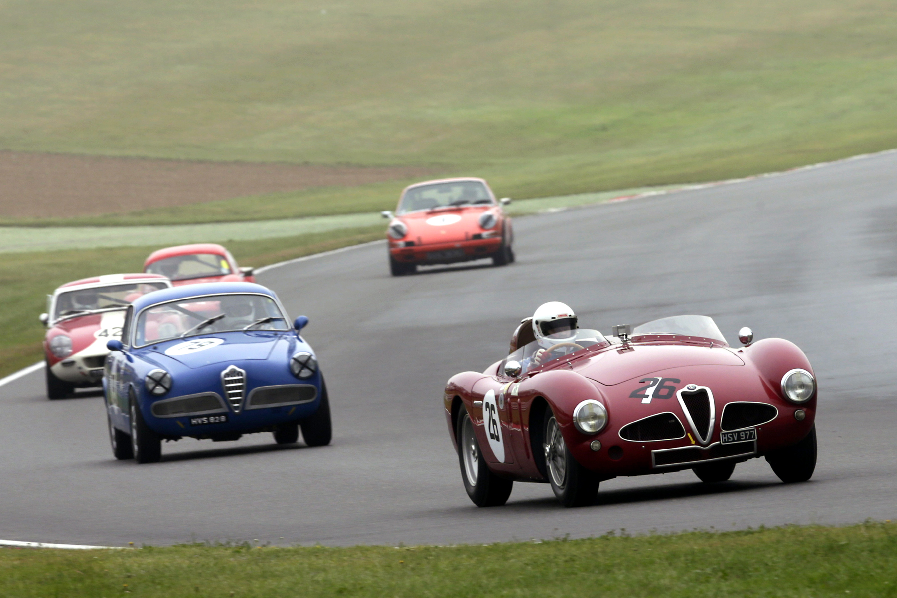 All Alfa battle. Peter Shaw in the Guilietta Sprint eventually got ahead of Christopher Mann  Photo - Gary Hawkins