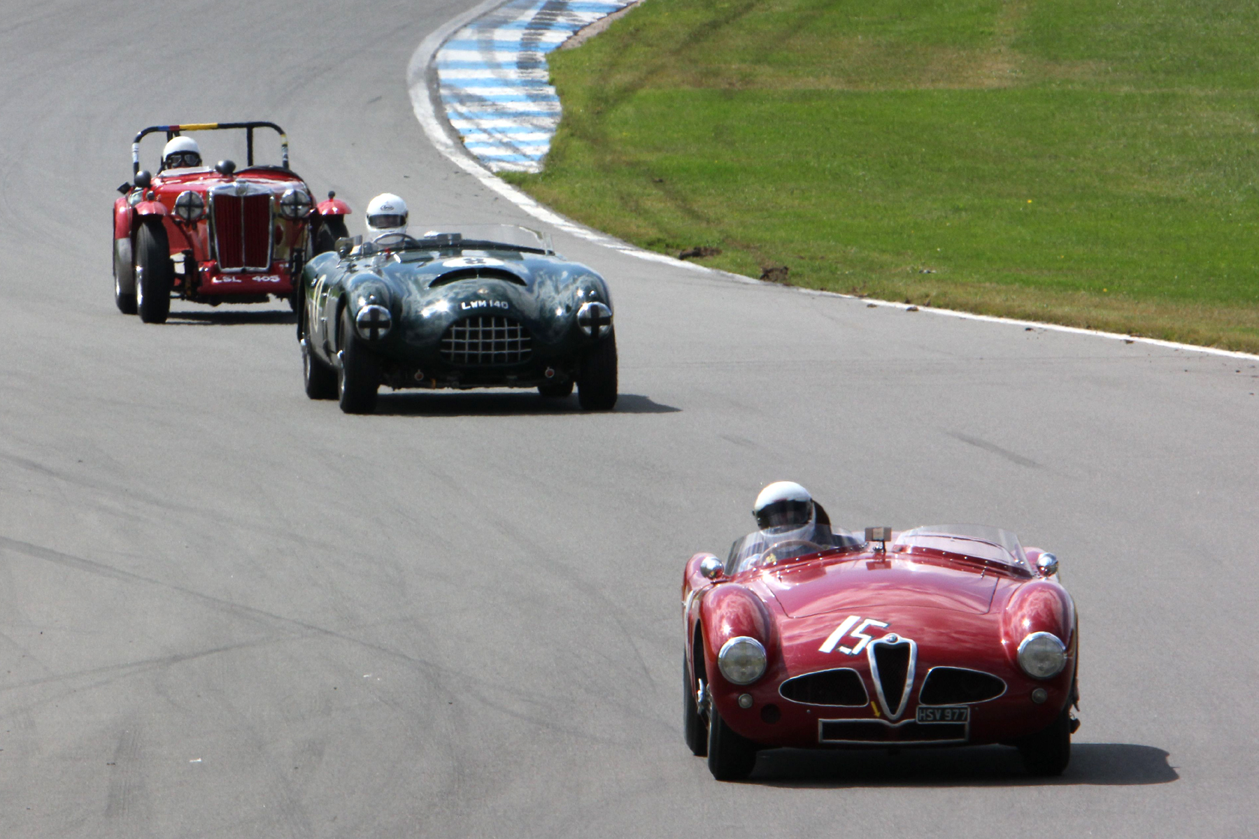 Chris Mann's Alfa Romeo Disco Volante heads the Gomm Jaguar Special and one of the MG 'T' Types  Photo - Pat Arculus