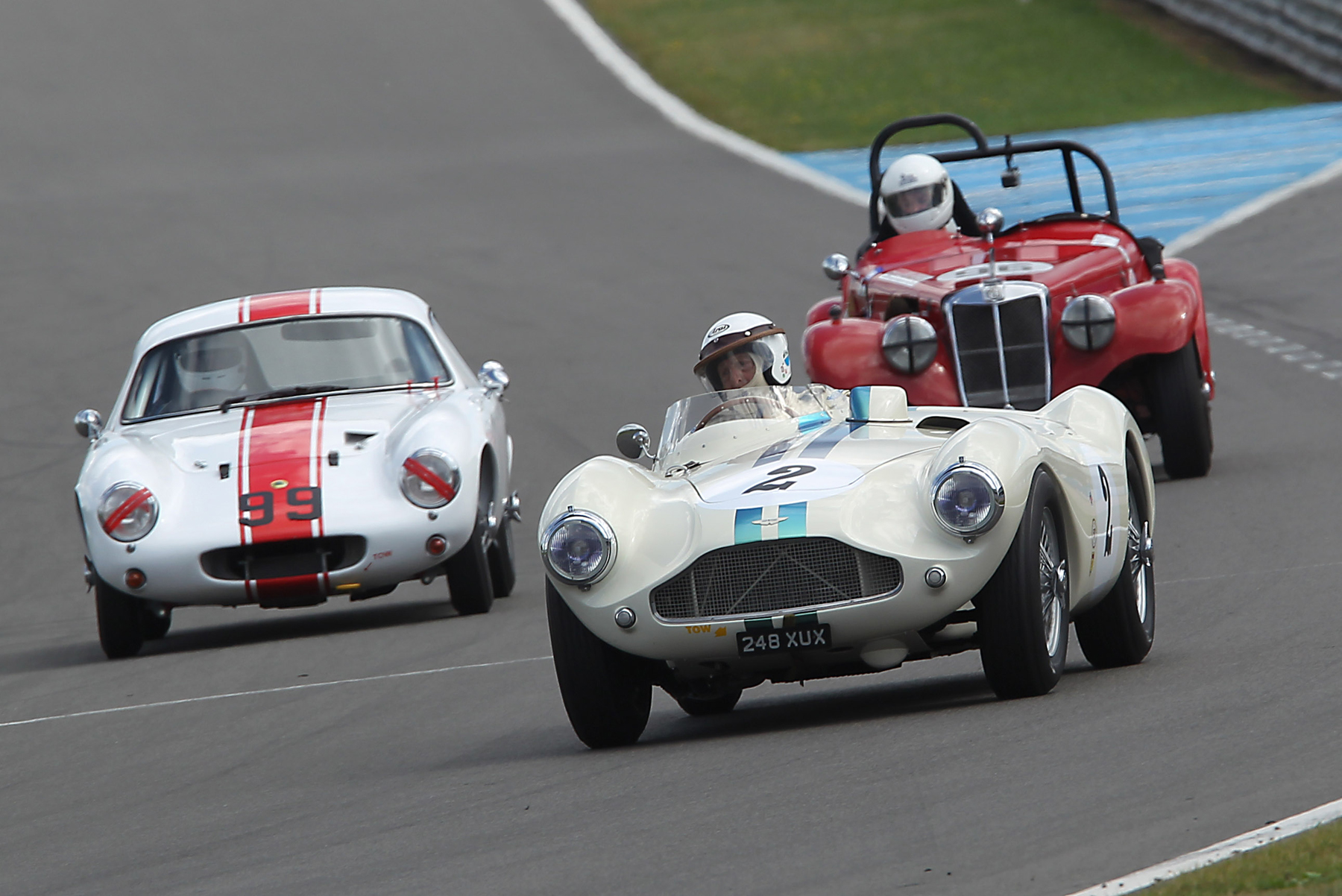 David Bennett took the Aston Martin DB3S to 8th. Here he leads John Waterson's Lotus Elite and Charles Harmers MG TF which later retired. A classic illustration of the variety of shape and development of sports cars during the 1950s.  Photo - Mick Walker
