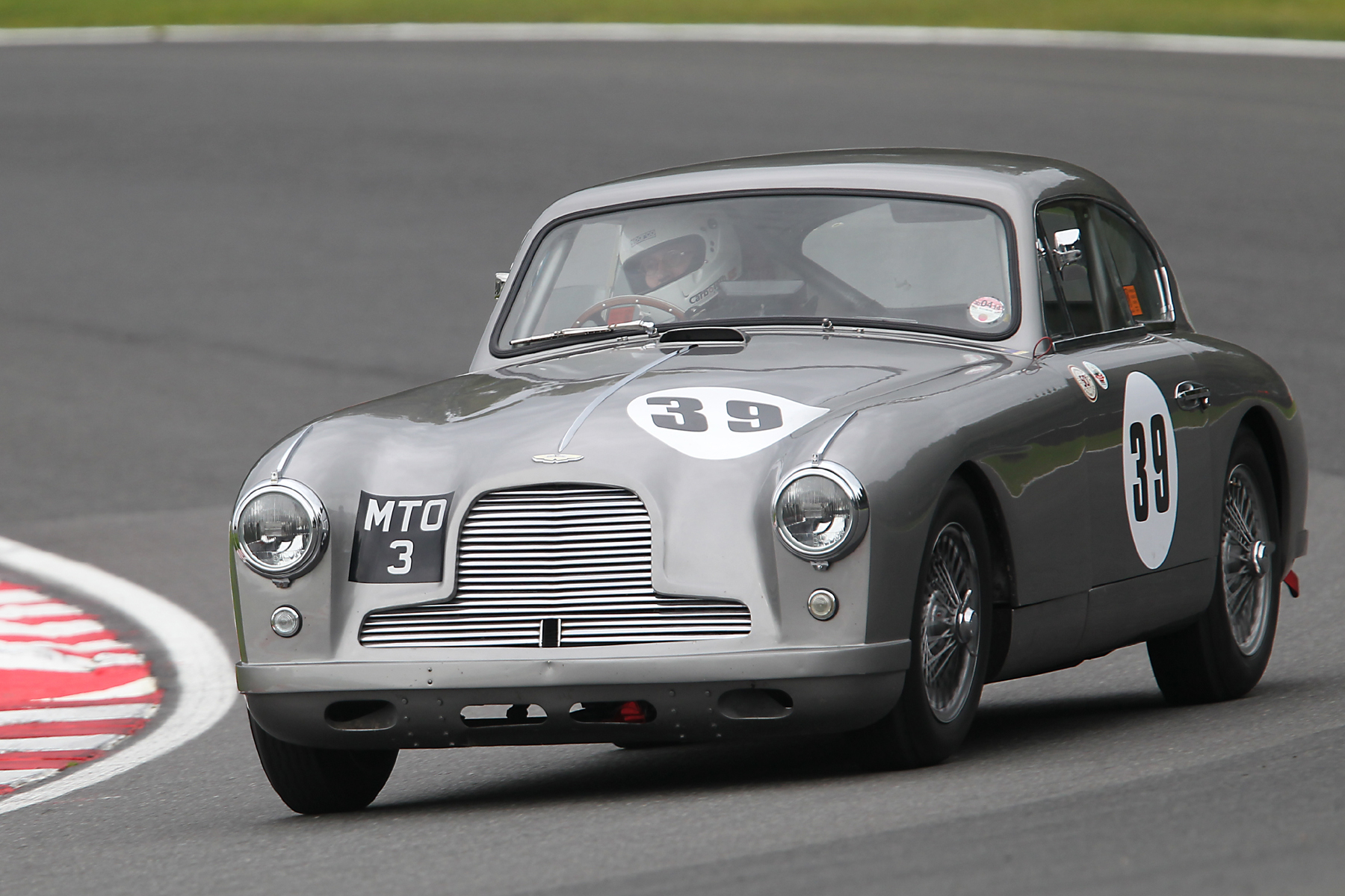 A DB2/4 returns to the ranks. Tim Stamper in Richard Bell's lovely Aston Martin.           Photo - Mick Walker