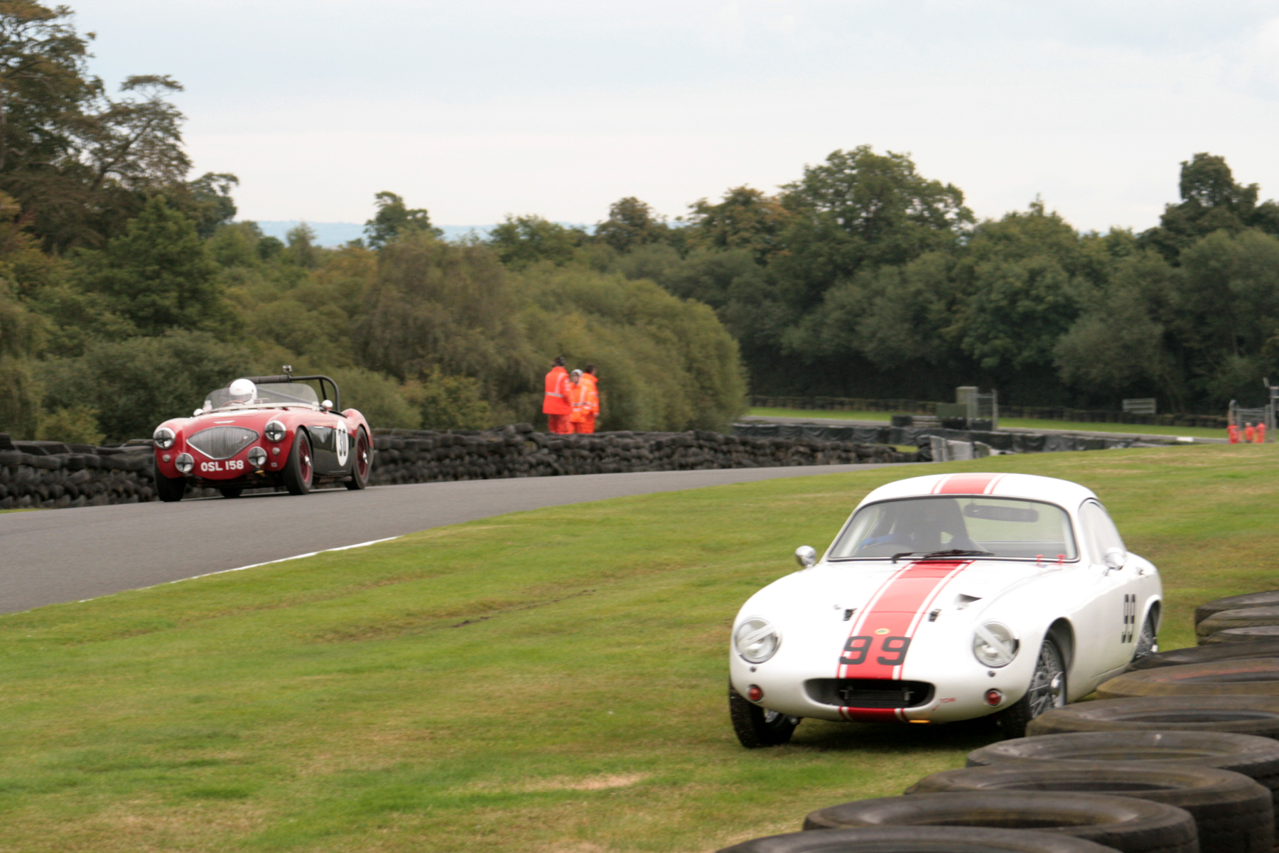 The Pugh-Lewis/Jenkins Austin Healey passes the stricken Waterson Elite.             Photo - John  Turner