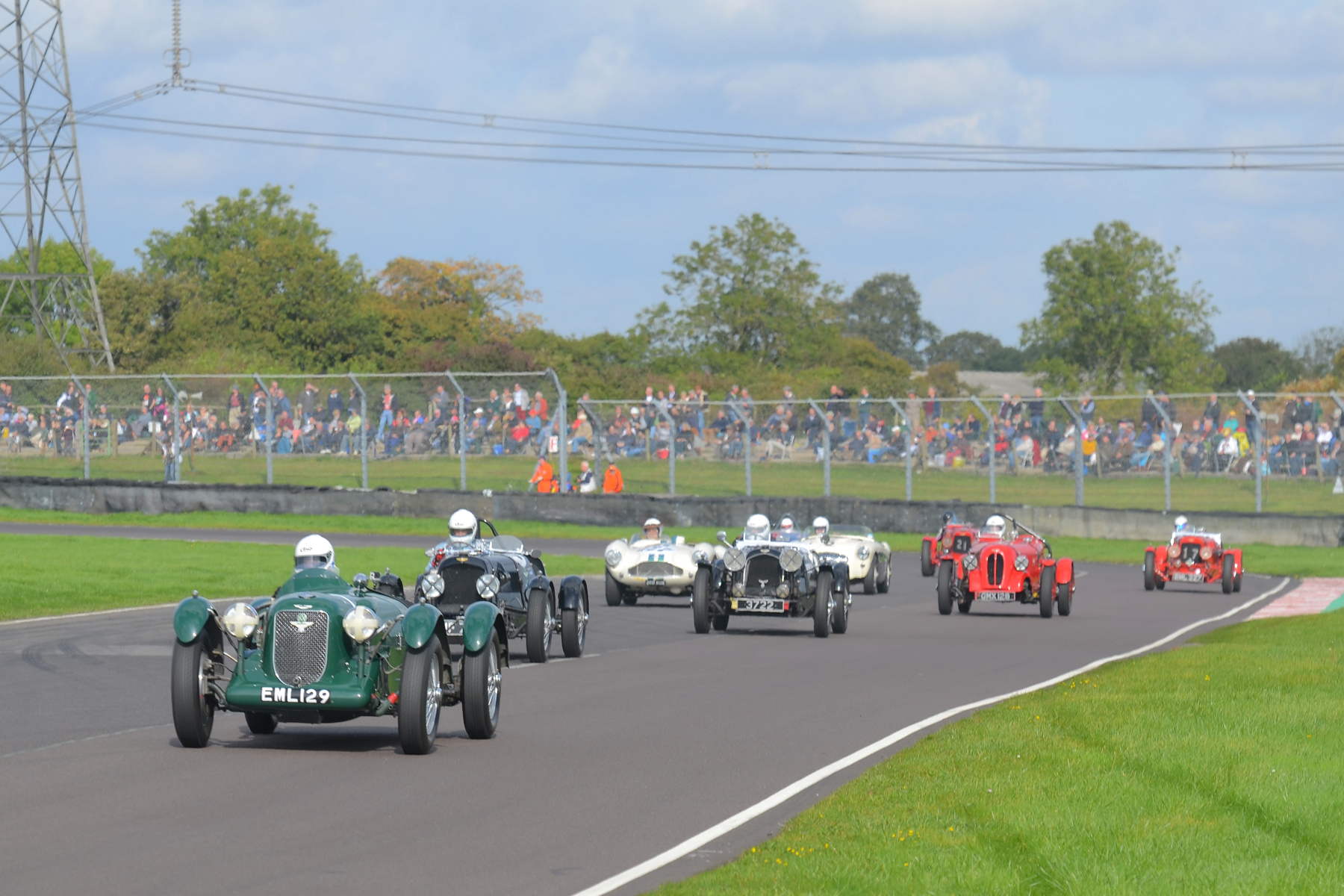 Further back but still on first lap, David Freeman leads the prewar Astons and a few of the postwar cars. The leading 1500cc Aston at this point is car 17 (Ulster LM17) in the hands of Holly Mason-Franchitti (far right)      Photo - Ollie Read