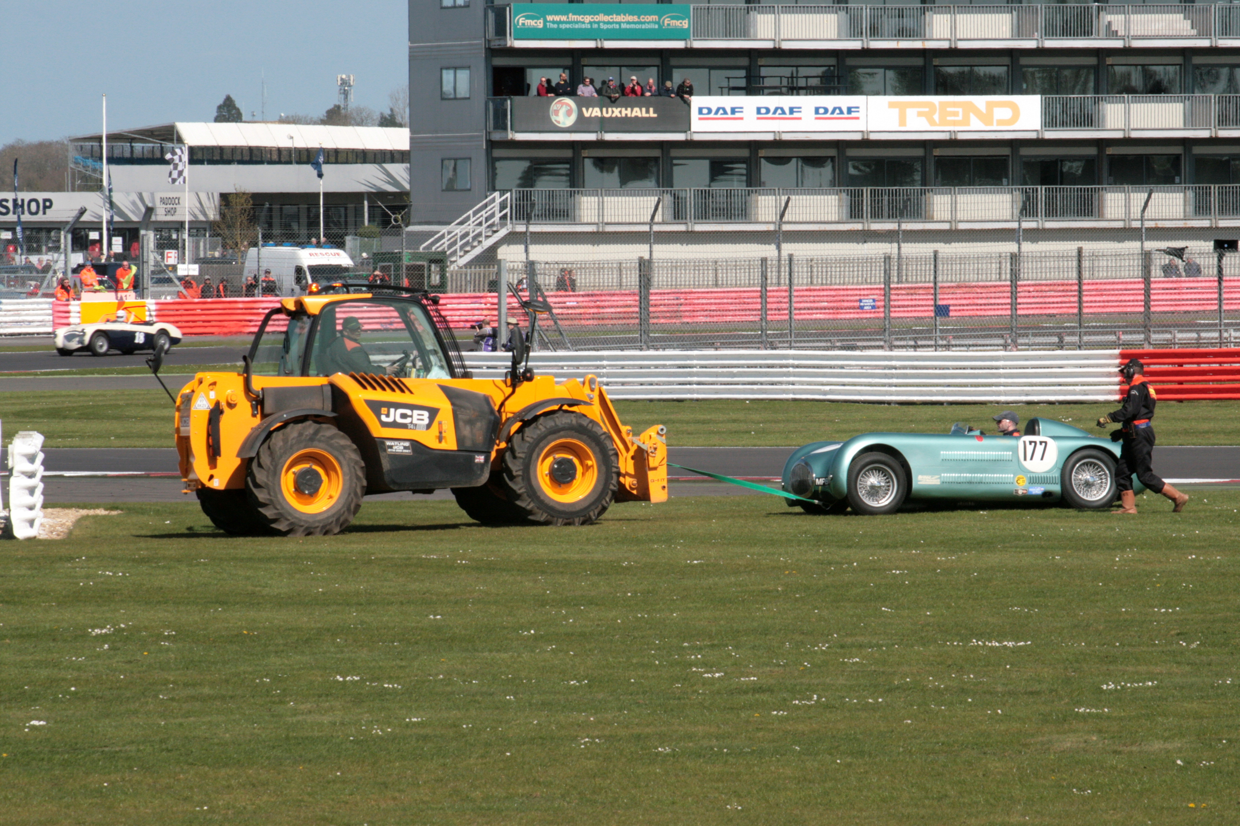 The usual splendid job done by the marshals - The unique stReamliner gets towed to safety      Photo - John Turner