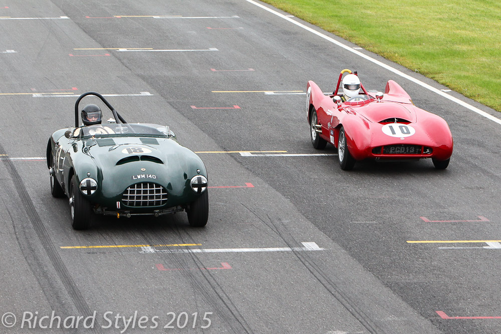 Overhead shot of Charles Fripp (Gomm Jaguar) being lapped by Malcolm Paul's Lotus Mk X
