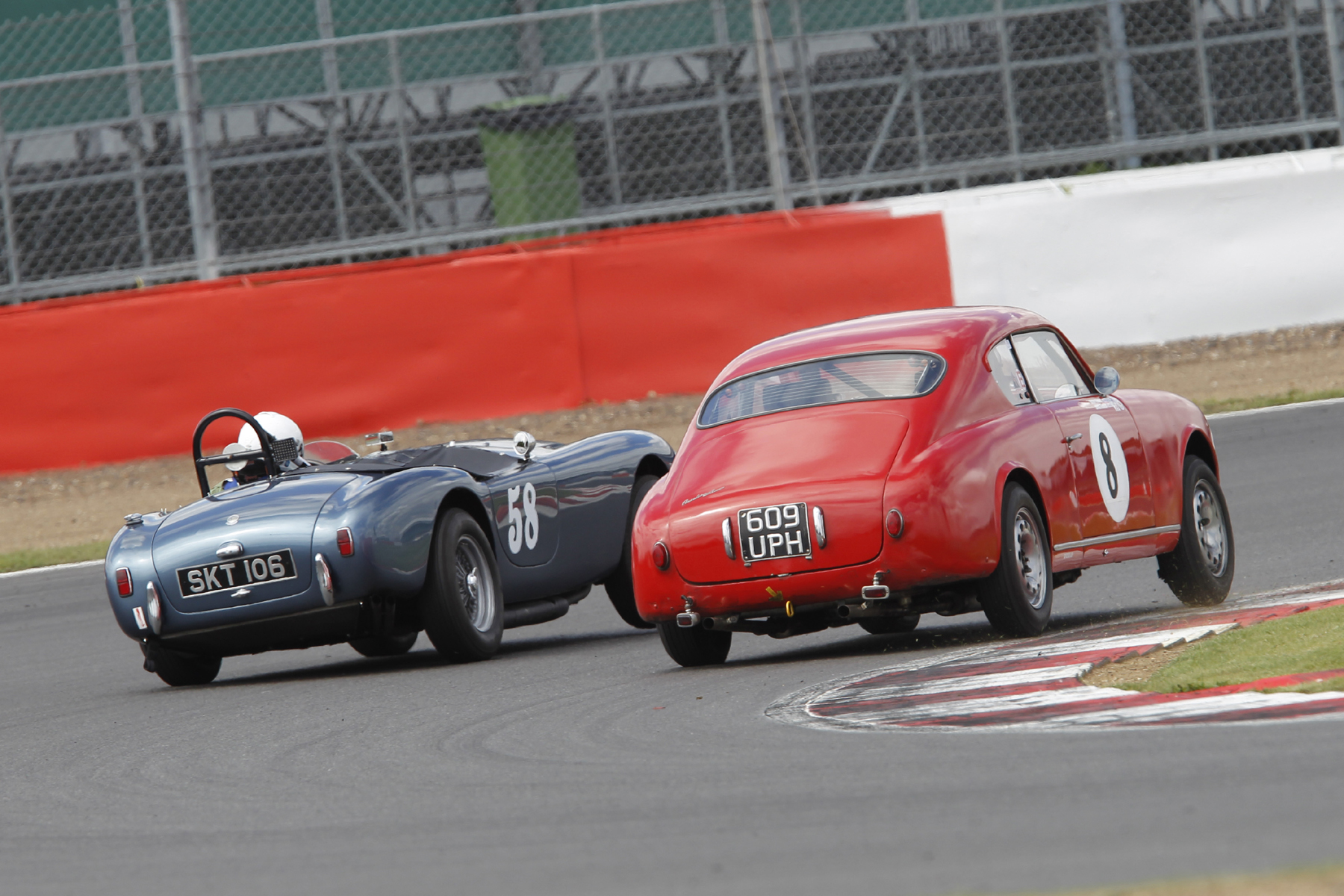 Synchronised leaning! Mark Morgan (AC Ace) and Jason Kennedy (Lancia Aurelia GT) 'slug it out'       Photo - Mick Walker