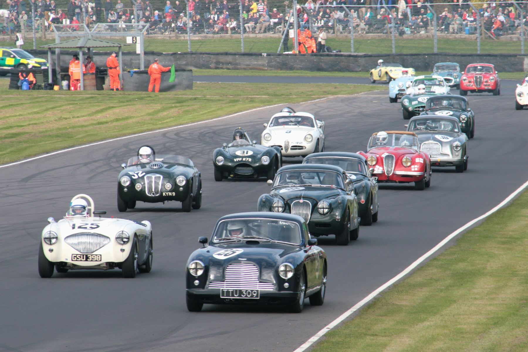This is just the rear half of our grid on its warming up lap. Disappointingly, Austen Kinsella failed to complete even one race lap in his rare Frazer Nash Targa Florio (No 52)                                                         Photo - John Turner