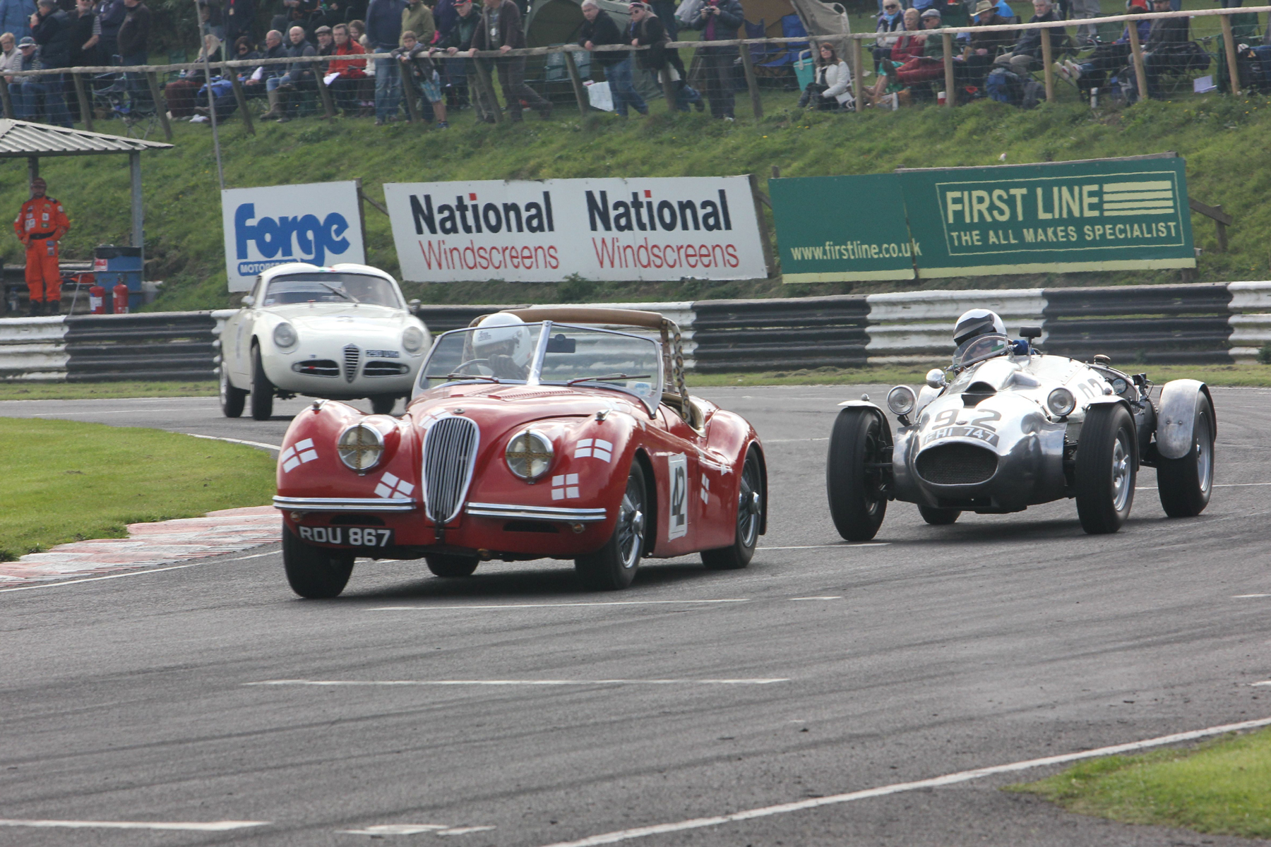 Geoff Ottley (XK120), Peter Campbell (Wingfield Bristol Special) and Brian Arculus (Alfa Romeo Guilietta SVZ) round Camp (last corner) at the end of lap 2.                                        Photo - Pat Arculus, Tripos Media