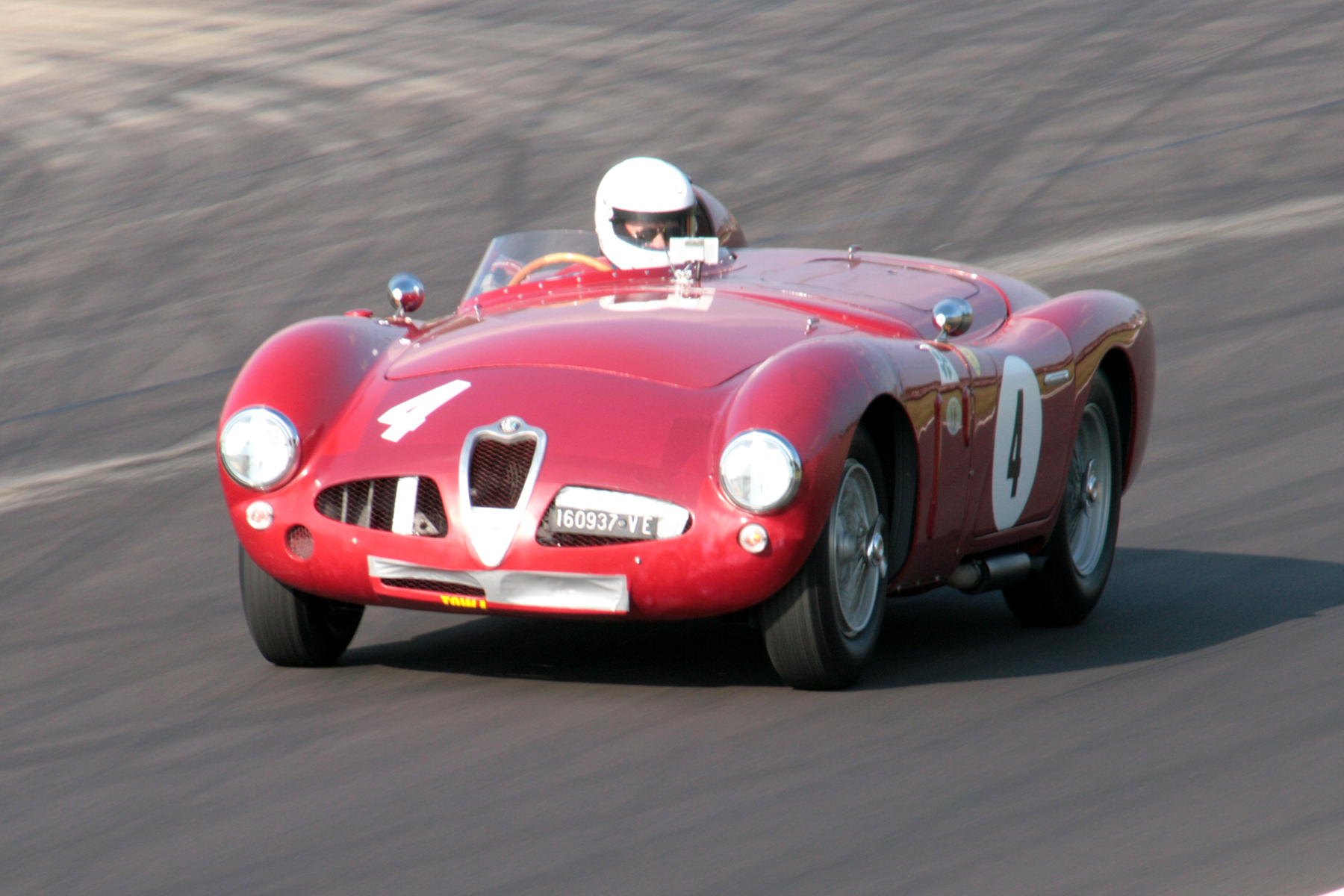 Still showing signs of its Goodwood Revival contretemps is the Alfa Romeo Disco Volante of Chris Mann. It looks as though Chris is looking down into the cockpit rather than at his mirror! He finished 24th.                            Photo - John Turner
