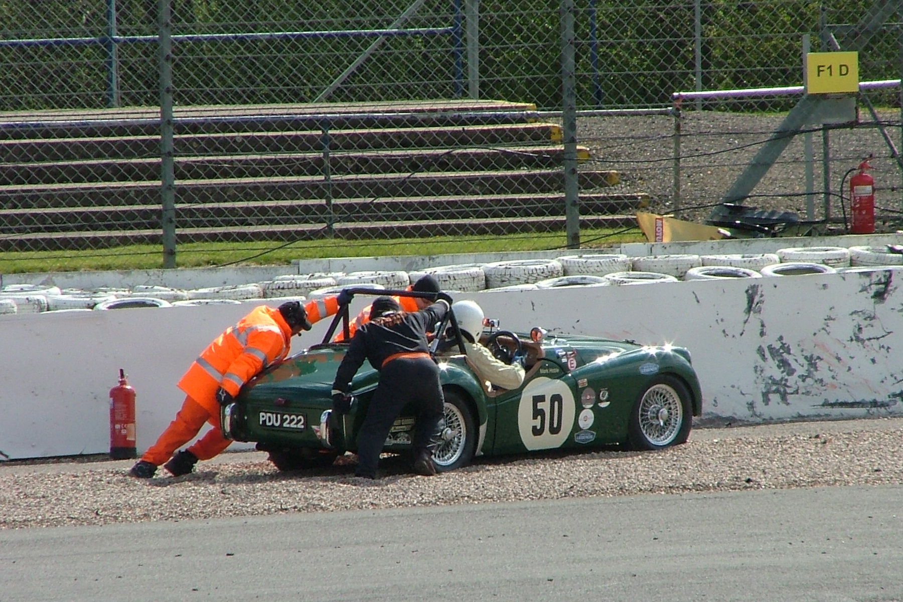 It was great to see Mark Hoble out with us in his Triumph TR2 after an absence of some years, but his practice was not without drama as a clutch problem forced him to pull off at the marshals post just beyond Copse. Mark resolved the problem and was able to start and finish the race.  Photo - John Turner