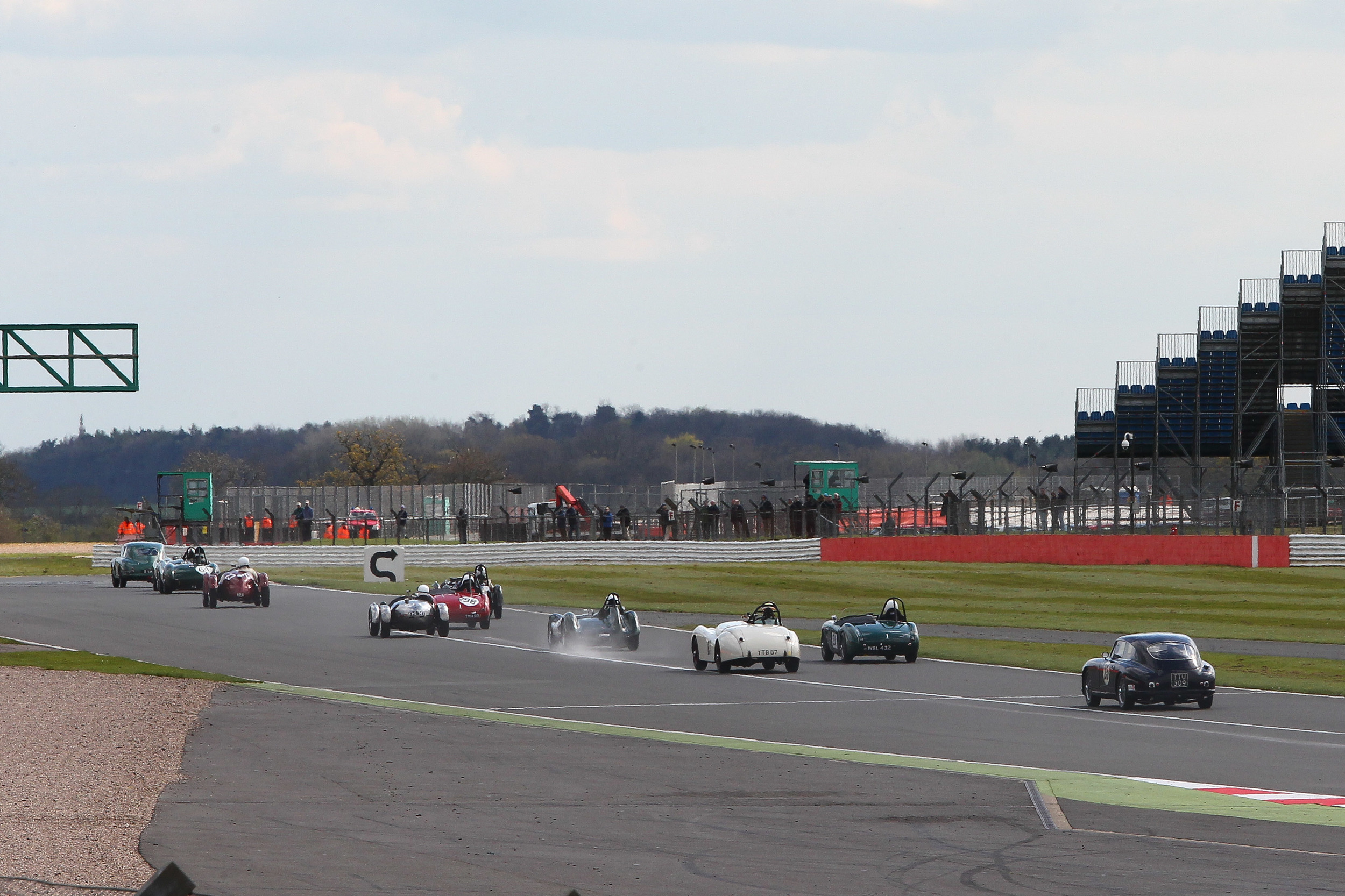 The leading cars stream away from Copse with Sharp being hounded by Boultbee Brooks and McWhirter. Photo - Richard Styles