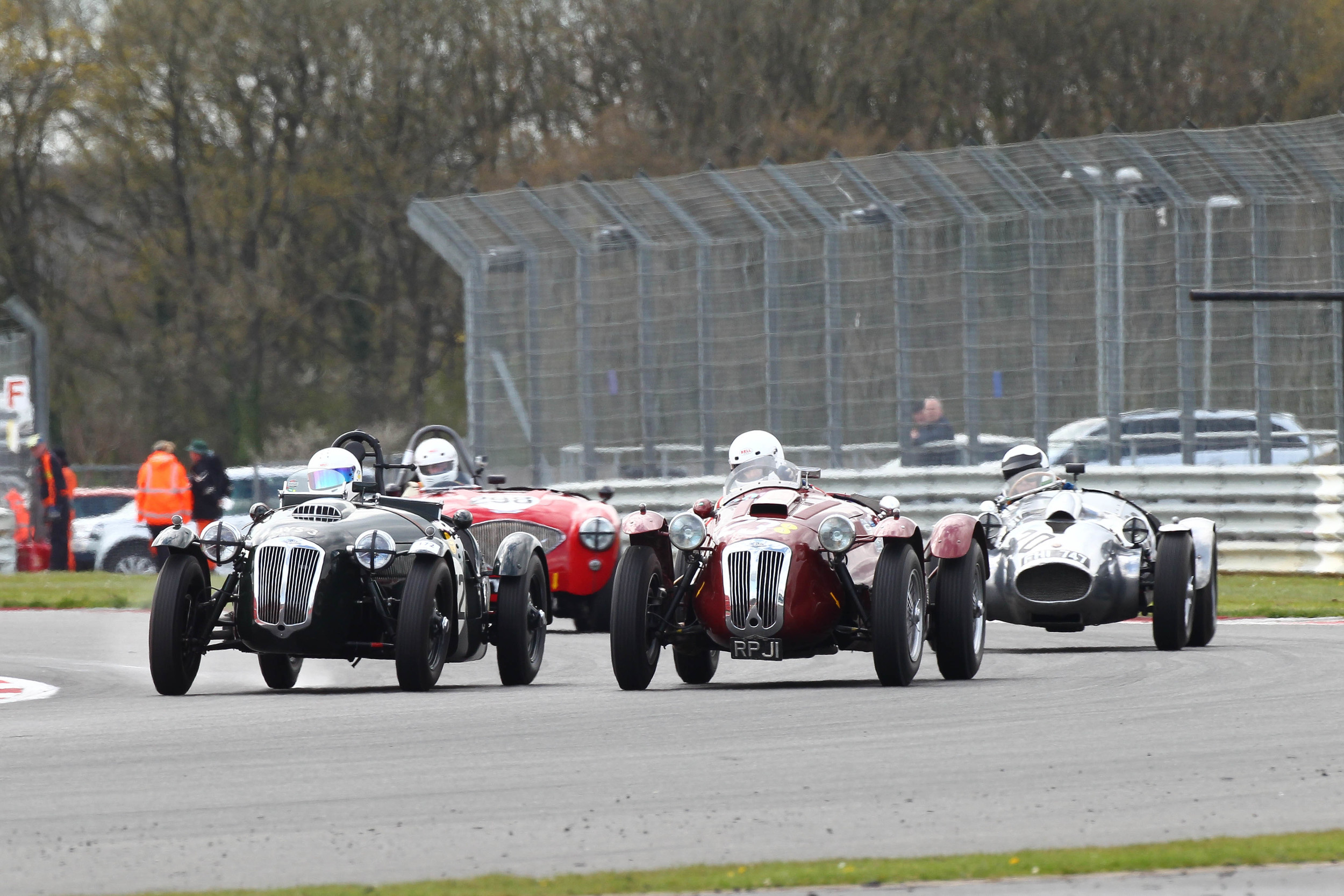 Ian Dalglish on the inside, John Ure on the outside both in Frazer Nash Le Mans Replicas whilst Peter Campbell (Wingfield Bristol) and Nick Matthews (Austin Healey) maintain a close watching brief.                                           Photo - Richard Styles