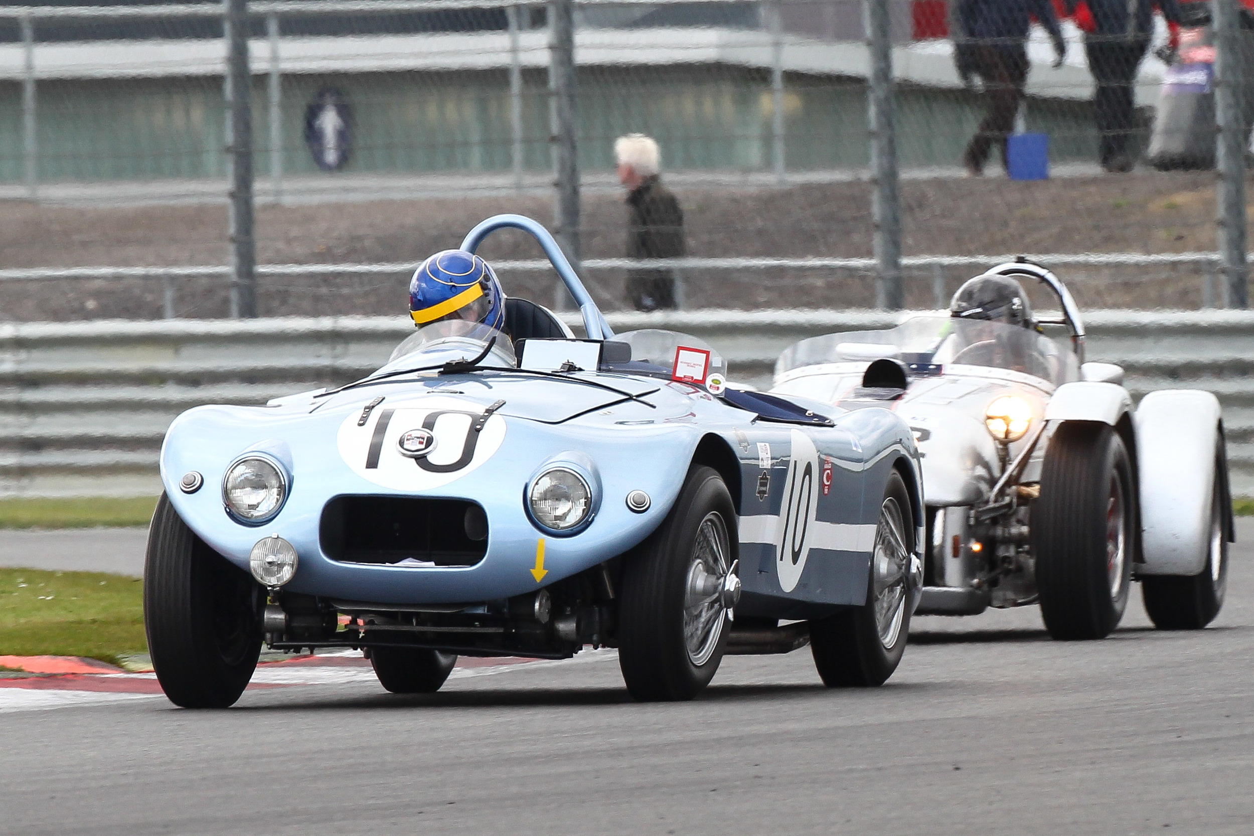 Sam Stretton in the Nash Healey about to be passed by Chris Guest in the Kurtis as the latter stormed through the field.      Photo - Richard Styles