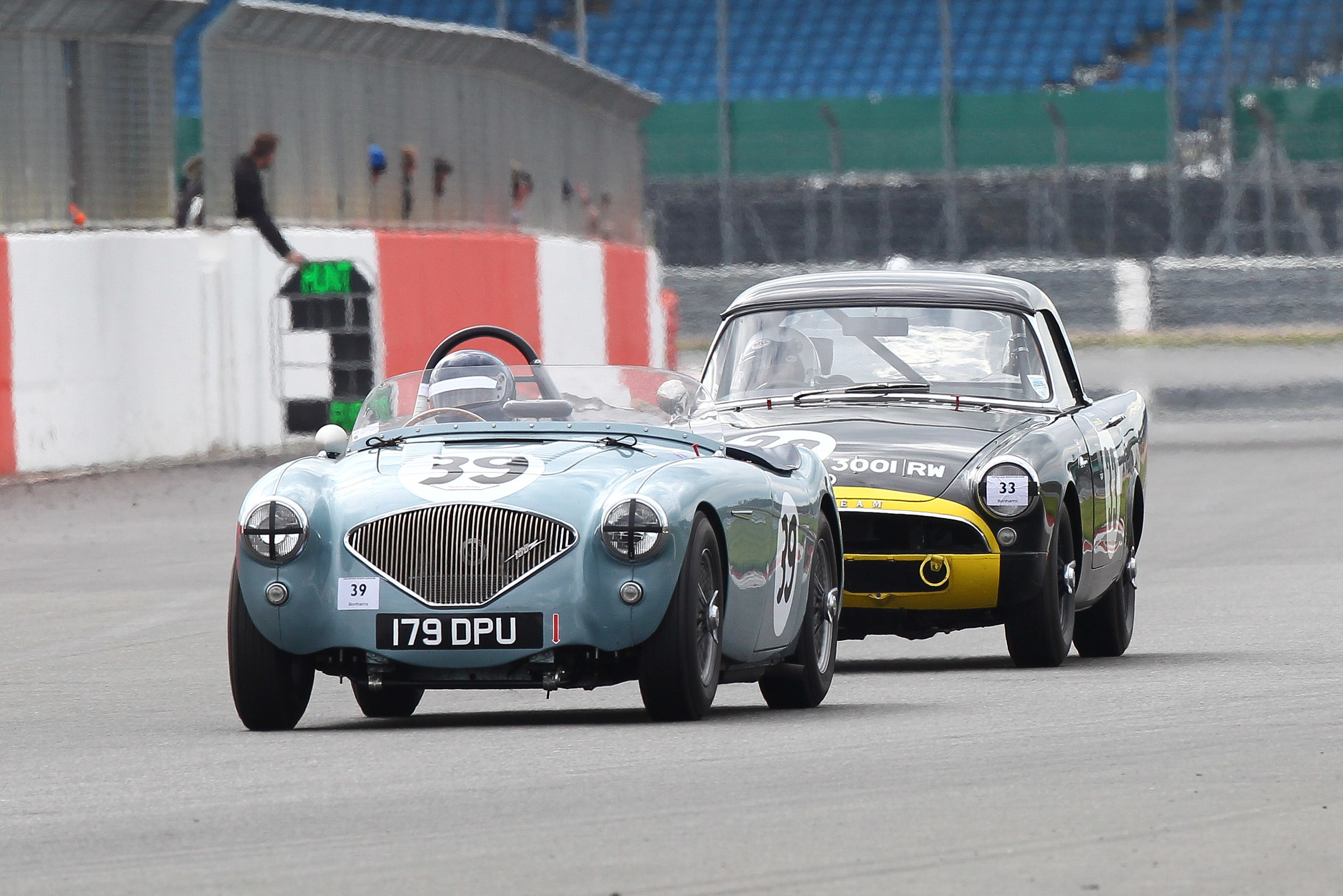 Superb dice between Robert Clarke (Austin Healey 100/4) and Keith Hampson (Sunbeam Alpine Le Mans)  went to the flag      Photo - Richard Styles