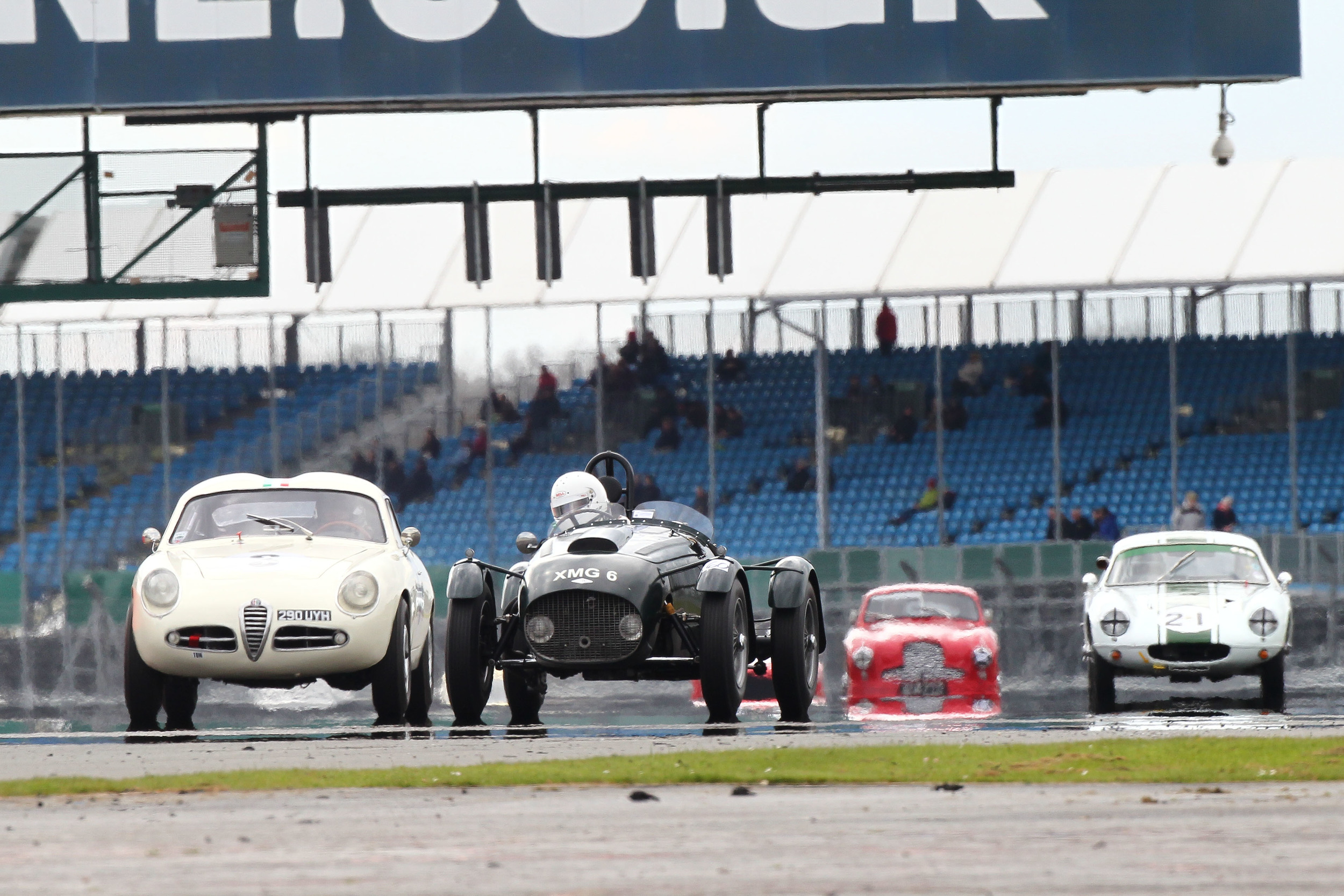 Brian Arculus (Alfa Romeo) and Martyn Corfield (FNLMR)fought an incredibly close duel. In the background Barry Dye's Lotus Elite and Paul Chase- Gardners Aston Martin DB2  Photo - Richard Styles