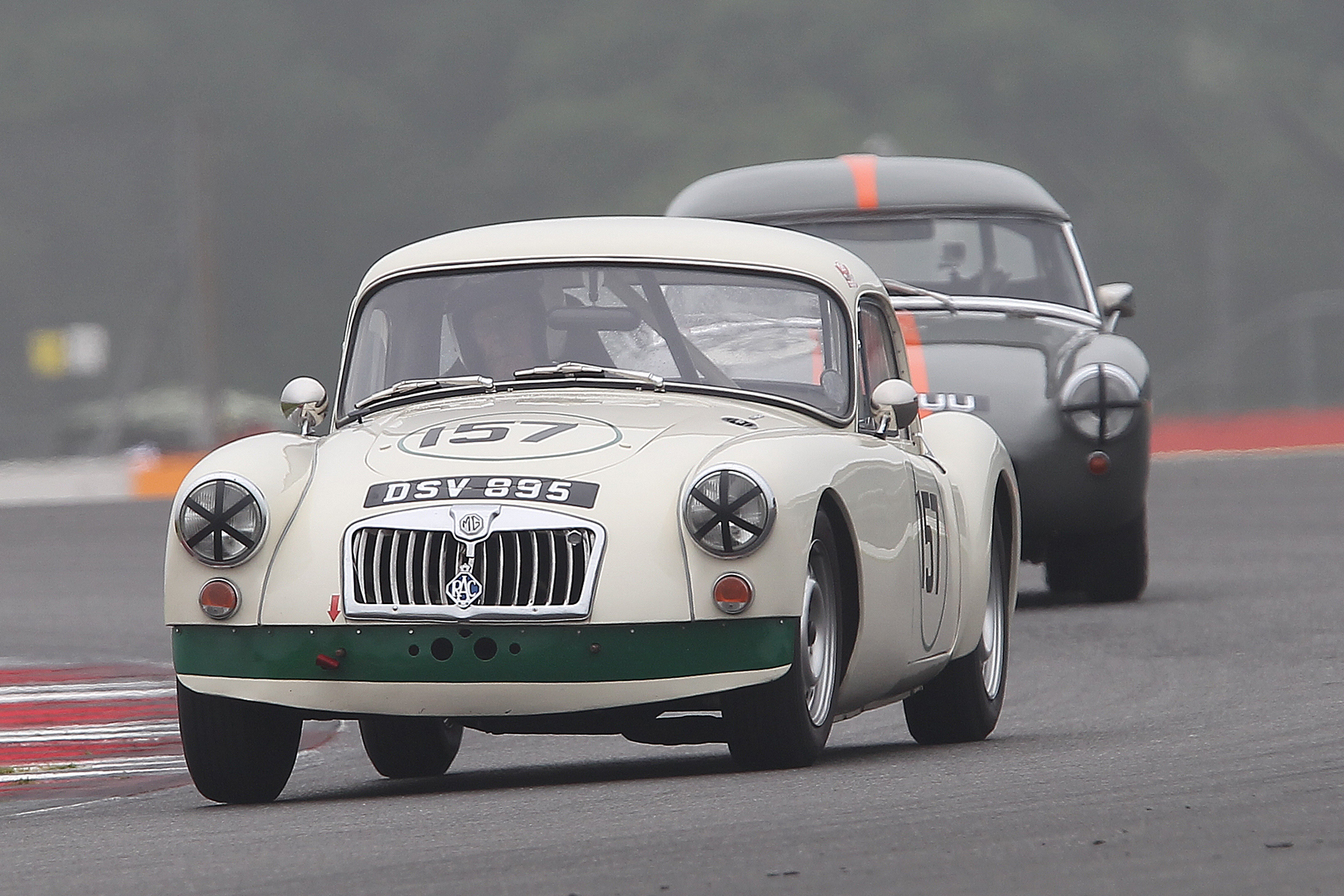 Simon Gurney's lovely MGA Coupe, our Class 4 winner leads the non FISCAR compliant but very pretty Sprite Mk 1 of Jim Mackie.  Photo - Mick Walker