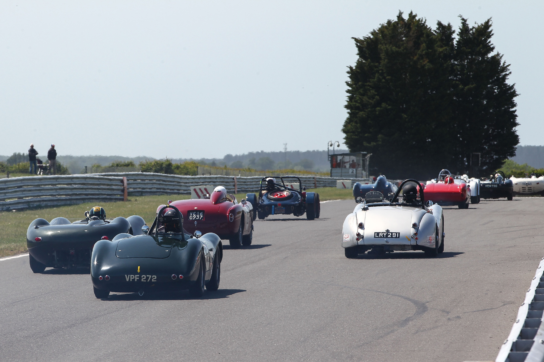 The rise from the startline is evident here as the cars head towards Riches. At the back is Paul Griffin's lovely ex Archie Scott Brown Connaught ALSR. To his left is Richard Last's Lister Jaguar. Ahead, is Chris Mann's Alfa Romeo Disco Volante alongside Andrew Wenman's Jaguar XK120 with the very stark rear end of Rob Manson's Baldwin Mercury Special from 1949 and therefore the oldest car in the race, ahead.  Photo - Richard Styles