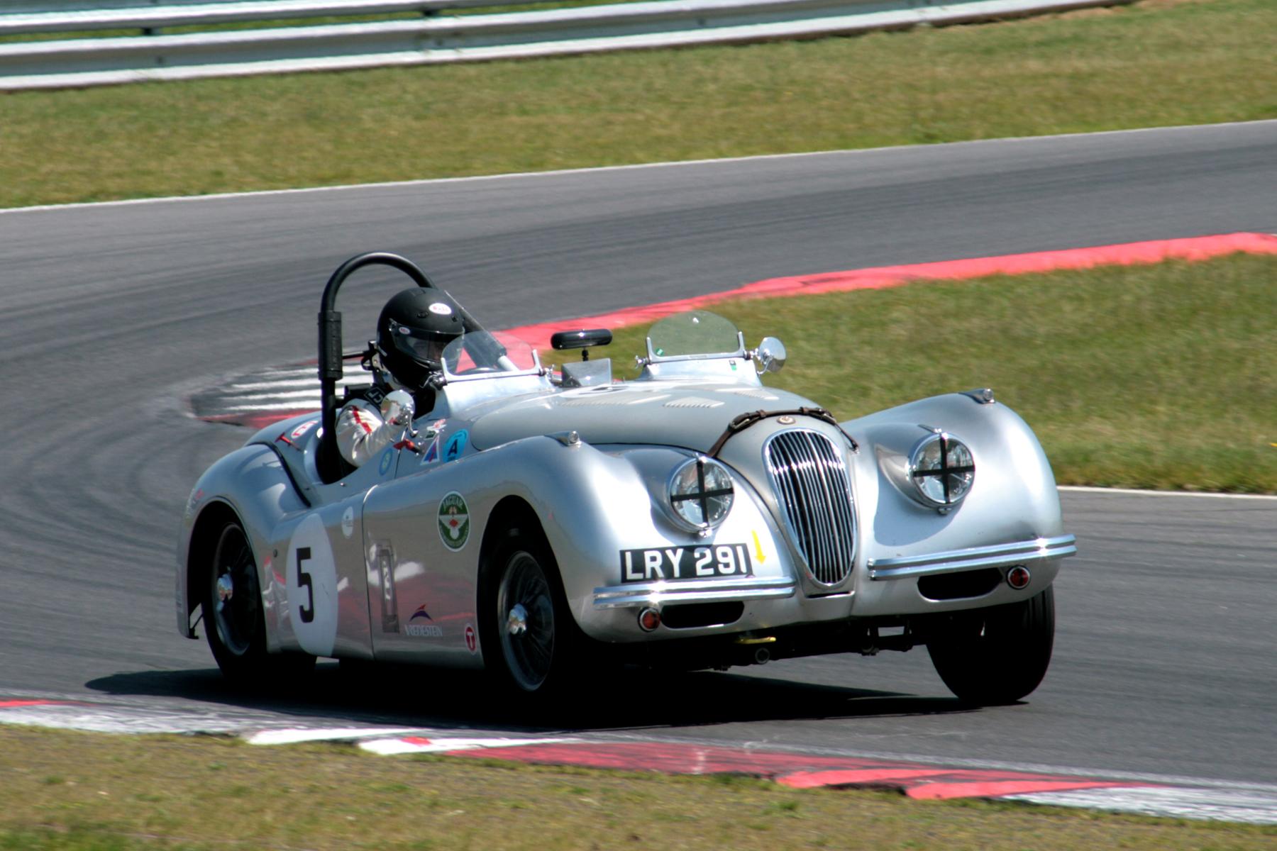 Andrew Wenman exits Murrays in his Jaguar XK 120  Photo - John Turner