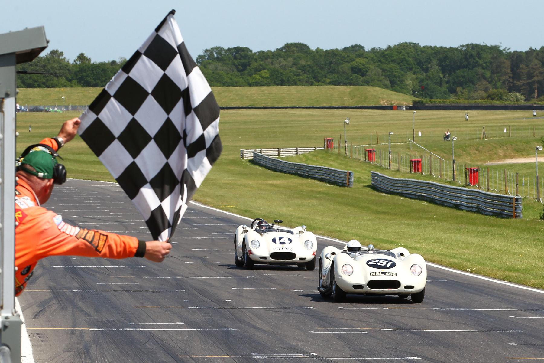 Mark Lewis takes the flag just ahead of Roberto Giordanelli  Photo - Richard Styles