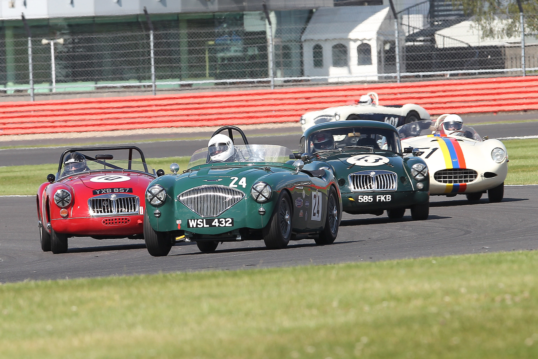 Jim Campbell leads Glen Tollett and Nigel Winchester as they lap Terry Bryant's MGA (10) Photo - Mick Walker