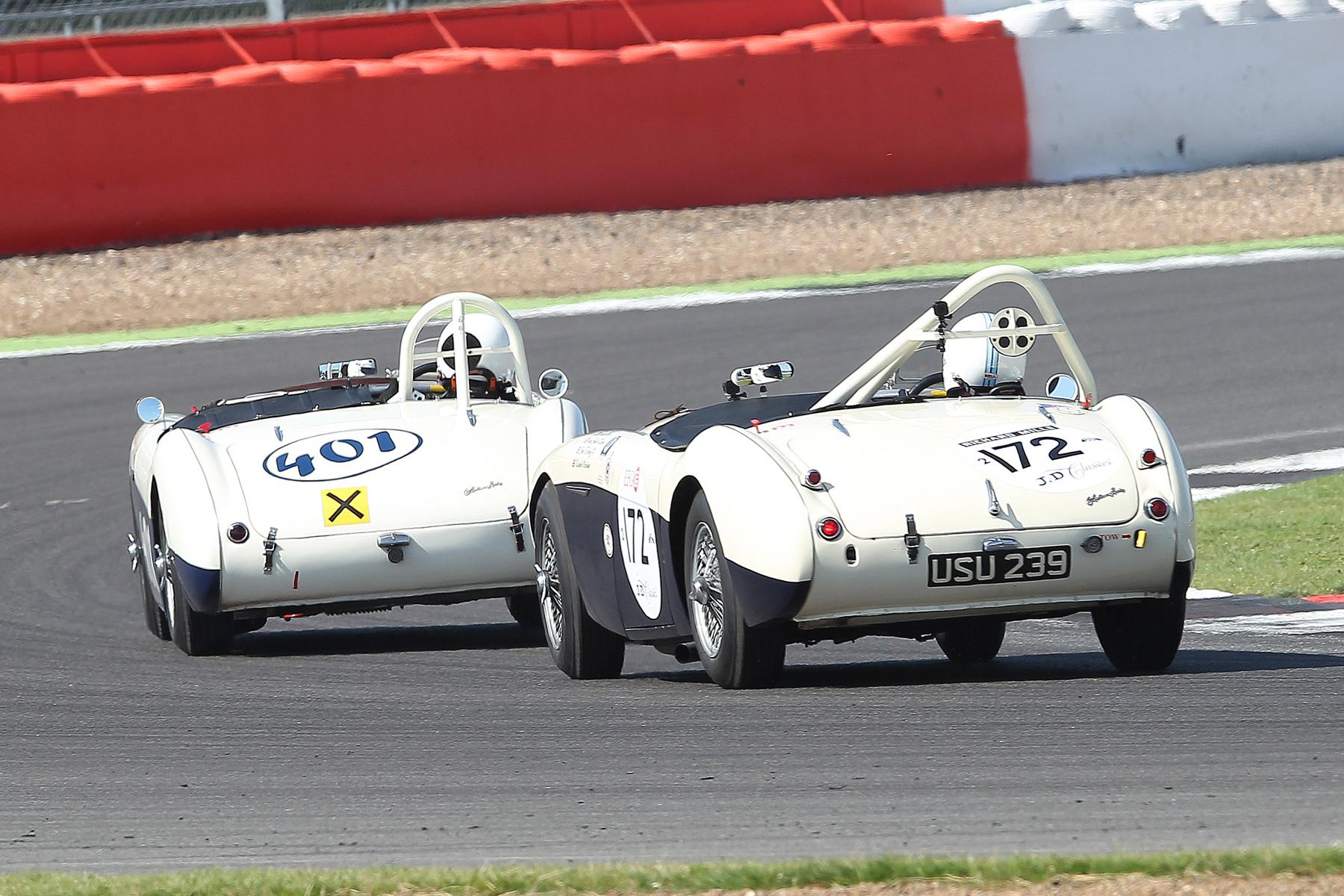 Jason Harris (Austin Healey 100/4) leads Graham Robson (Austin Healey 100M) in their great dice. Photo - Mick Walker