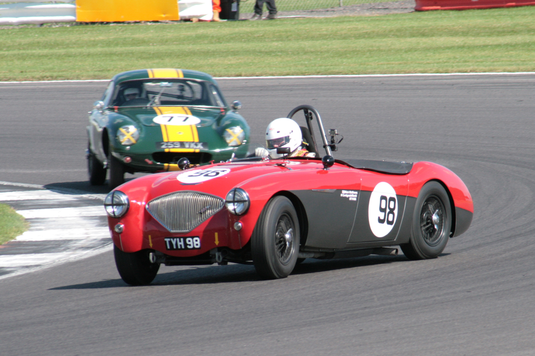 Nick Matthews opposite locking in Luffield in his battle with Mike Freeman before their pit stops  Photo - John Turner