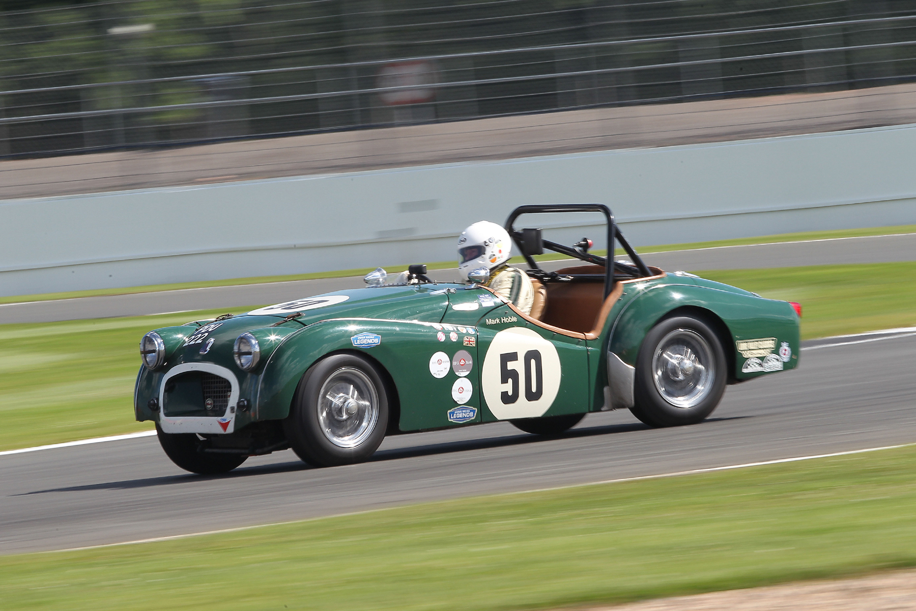 Mark Hoble with a touch of opposite lock in his Triumph TR2  Photo - Mick Walker