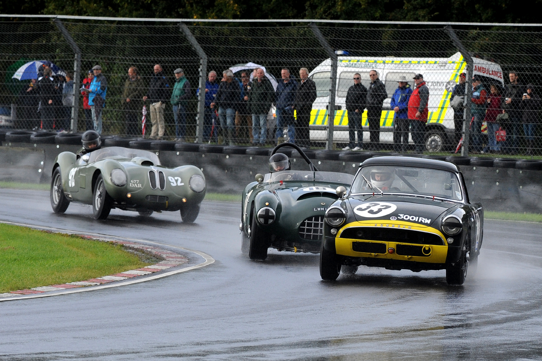 These photos surely show FISCAR at its best. Keith Hampson in his Sunbeam Alpine Le Mans leads Charles Fripp in the unique Gomm Jaguar and Tom McWhirter in the splendid Tojeiro Bristol                                                                                    Photo - Jeff Bloxham