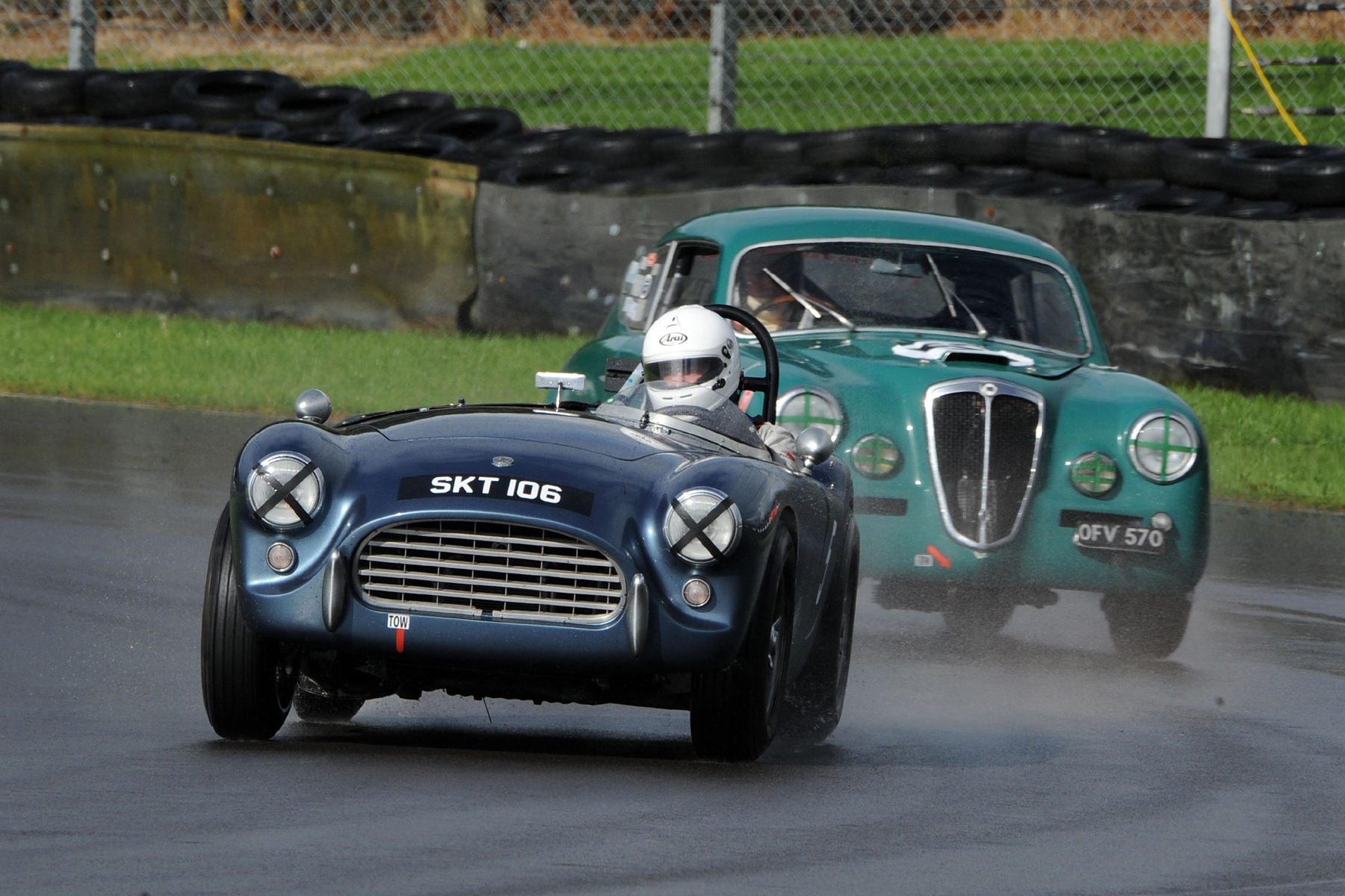 Mark Morgan in his AC Ace Bristol. Chris Gawne follows him through Quarry in his Lancia Aurelia B20GT             Photo - Jeff Bloxham