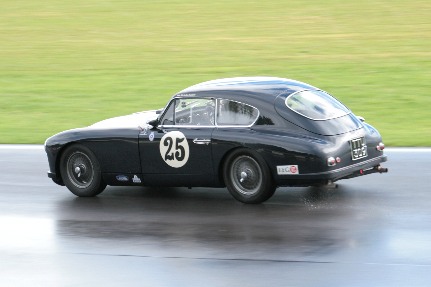 Nick Ruddell on his way to 13th overall in his Aston Martin DB2/4. He was to race again later in the day, in the Jon Gross memorial Trophy.  Photo - John Turner