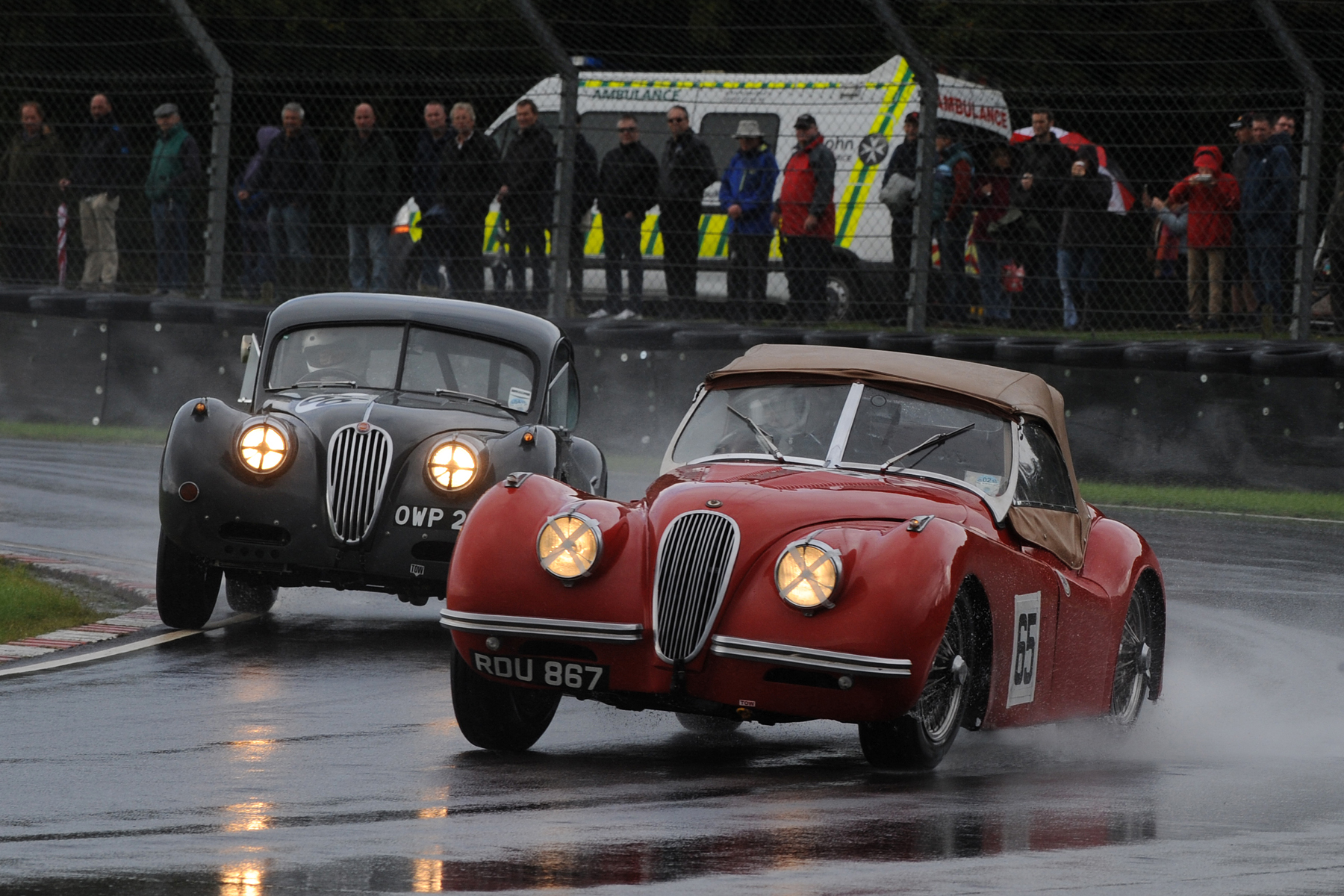 Geoff Ottley leads Kevin Zwolinski in their all XK120 early battle for 2nd place                        Photo - Jeff Bloxham