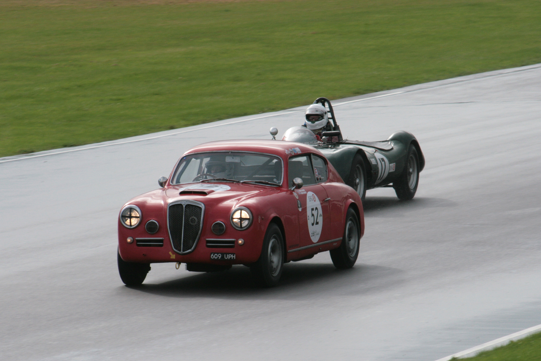 Louise Kennedy heads towards Folly in the Lancia Aurelia B20GT with Alex Quattlebaum about to lap in the LECo2            Photo - John Turner