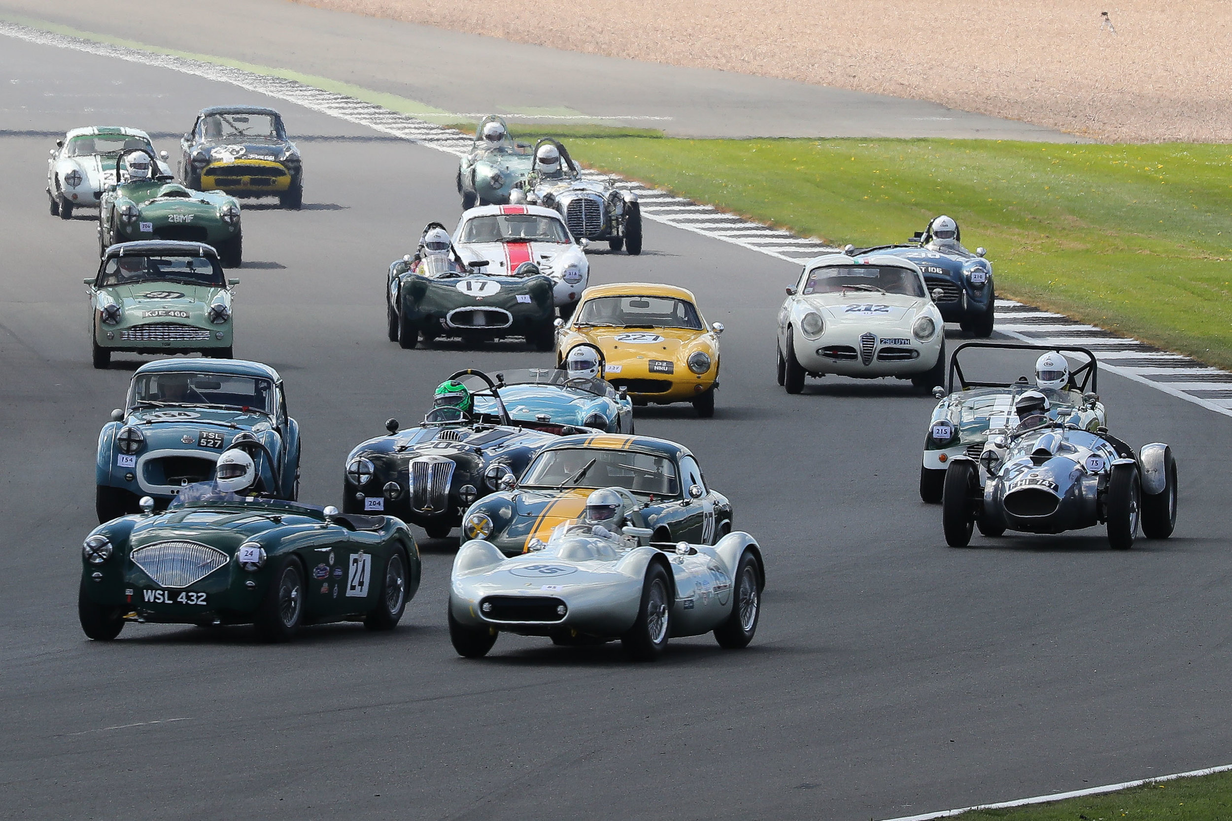 All great cars up to and including the final row. Stephen Bond in his Lister Bristol alongside Jim Campbell in his Austin Healey 100/4. To our right is Peter Campbell's one off Wingfield Bristol Special. There are 4 Elites here, the leading one of Mike Freeman but the yellow one driven by Gideon Hudson is new to our series.                                                                                          Photo - Richard Styles