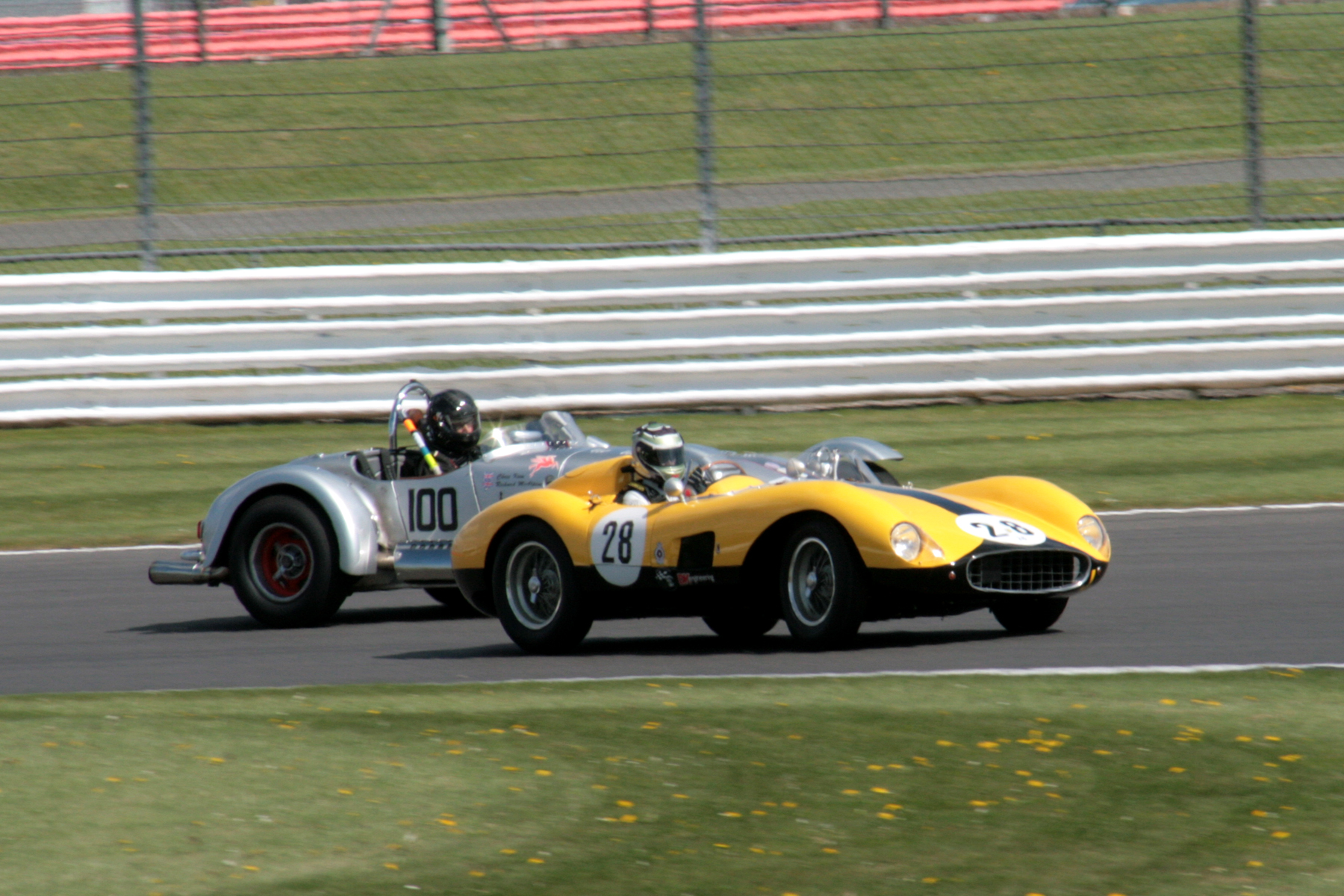 James Cottingham hits the front in the Ferrari 500TRC whilst Chris Keen hangs on the outside in the Kurtis 500S as they head into Luffield for the first time.                                                                                                                                                   Photo - John Turner