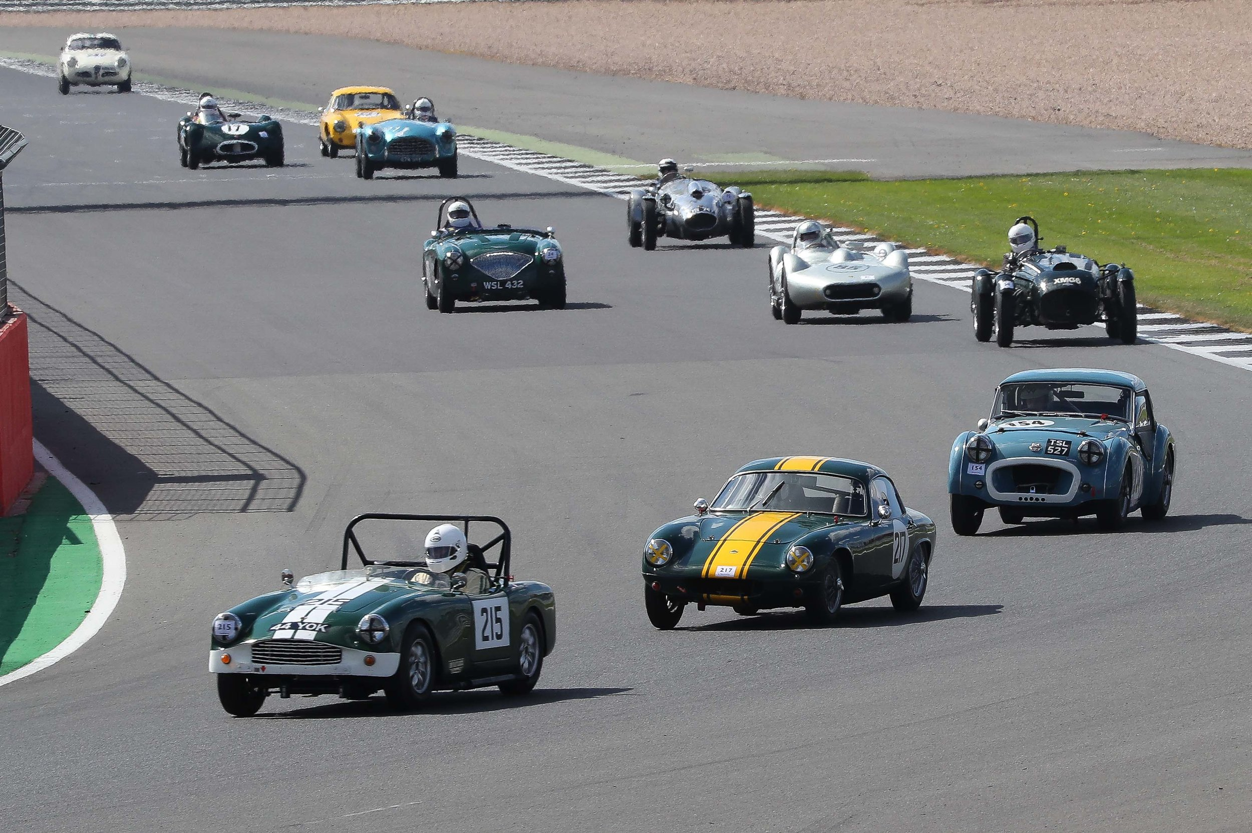 Paul Ziller in the TR2 was on a mission and had passed all those cars strung out behind him and latched onto the Turner /Lotus battle to make it a 3 way struggle. Just behind, Martyn Corfield in his Frazer Nash Le Mans Replica keeps ahead of the Lister Bristol/Austin Healey encounter whilst Peter Campbell in the Wingfield Bristol maintains a watching brief. Behind Peter is the AC Ace /Lotus Elite battle now joined by the LECo2 Sports of Alex Quattlebaum who had passed Brian Arculus in the Alfa Romeo Giulietta SVZ, seen in the background, on the previous lap.              Photo - Richard Styles