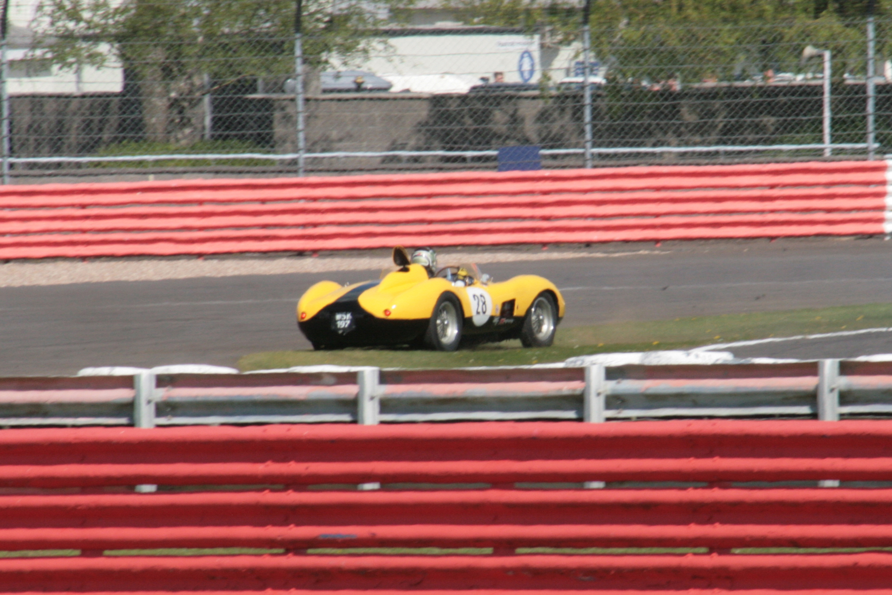 James Cottingham off in Brooklands. During the course of his gyration the fuel filler cap popped up and gave the Ferrari a bit of extra rear end downforce! Photo taken from a long way away  - well that's my excuse anyway                                            Photo - John Turner