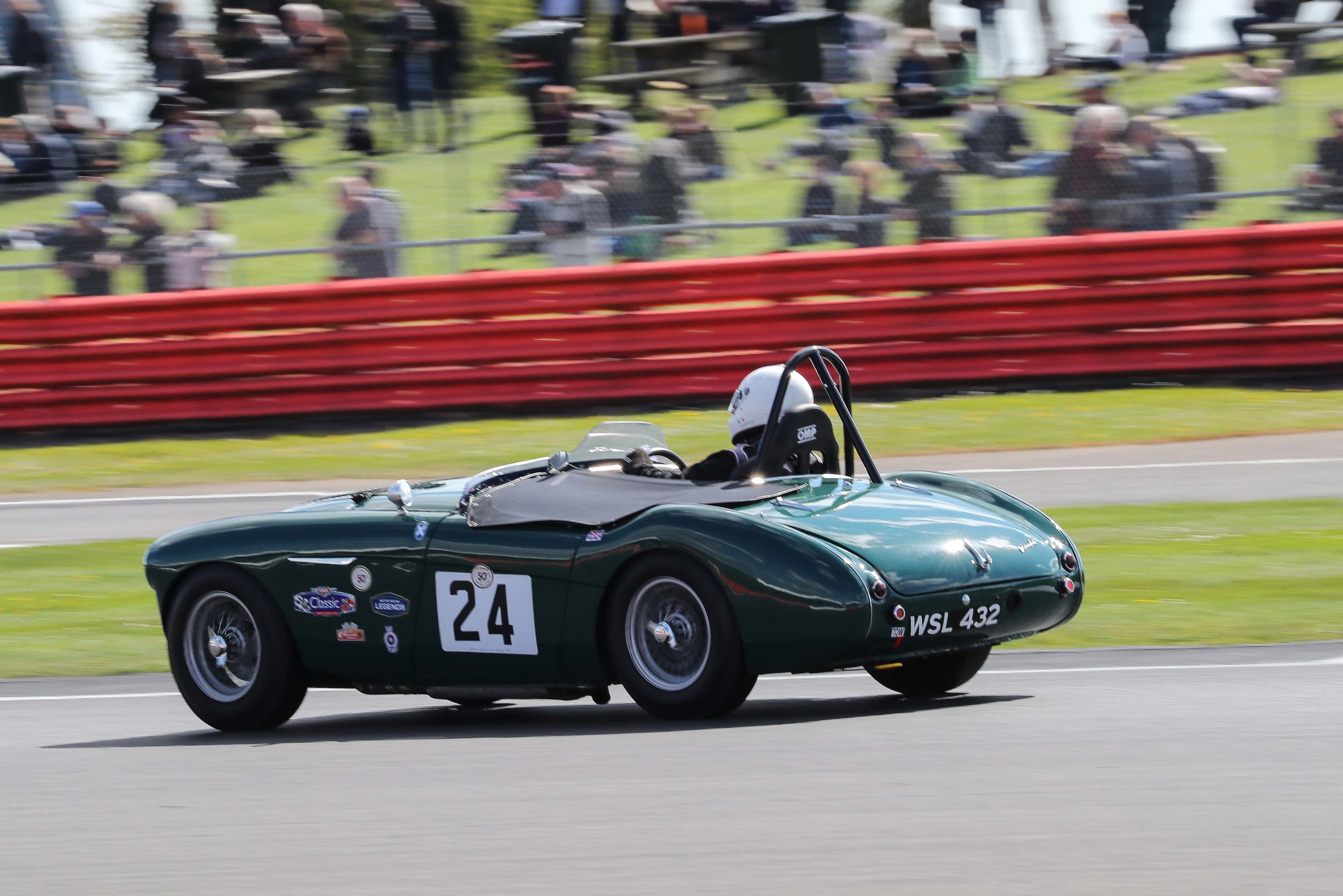Jim Campbell again displays an elegant and economical driving style in his Austin Healey.  He and Stephen Bond in the Lister Bristol were rarely far apart and Jim finished just 2 seconds down after 30 minutes of racing.                            Photo - Richard Styles