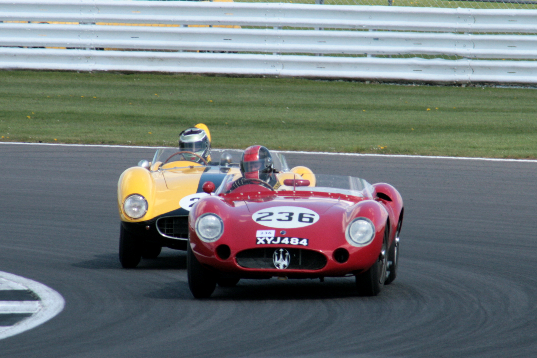 Superb battle for what was 2nd at the time between the Maserati and Ferrari                          Photo - John Turner