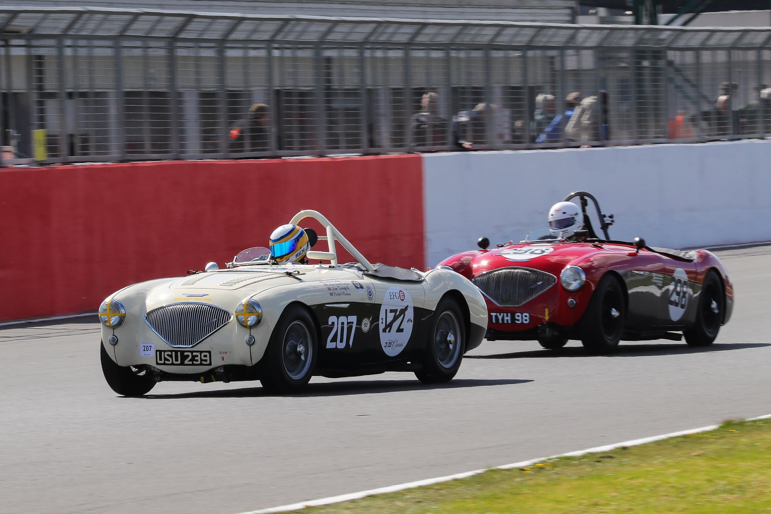 Richard Woolmer leads Nick Matthews in their great dice, before rear brake issues slowed the 207 car                       Photo - Richard Styles